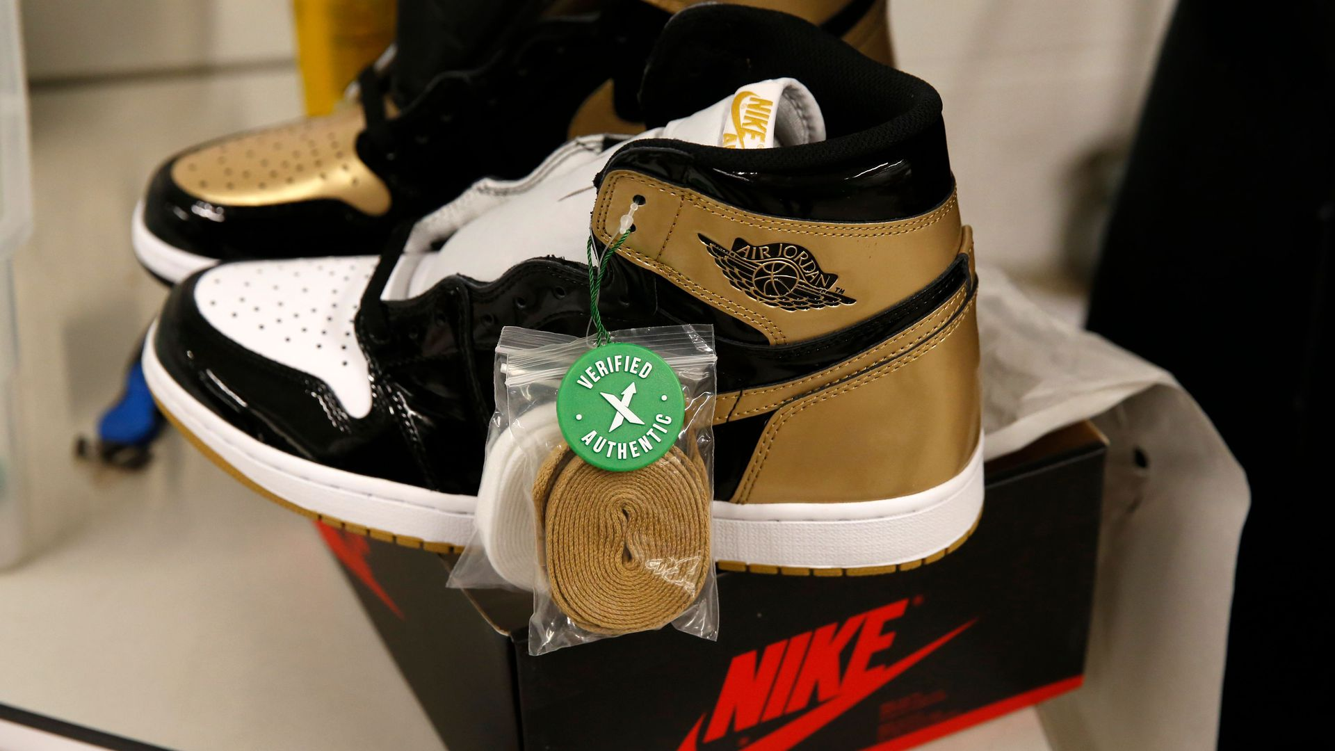 A pair of Air Jordan 1 Retro shoes are seen before being packed to ship out of Stock X