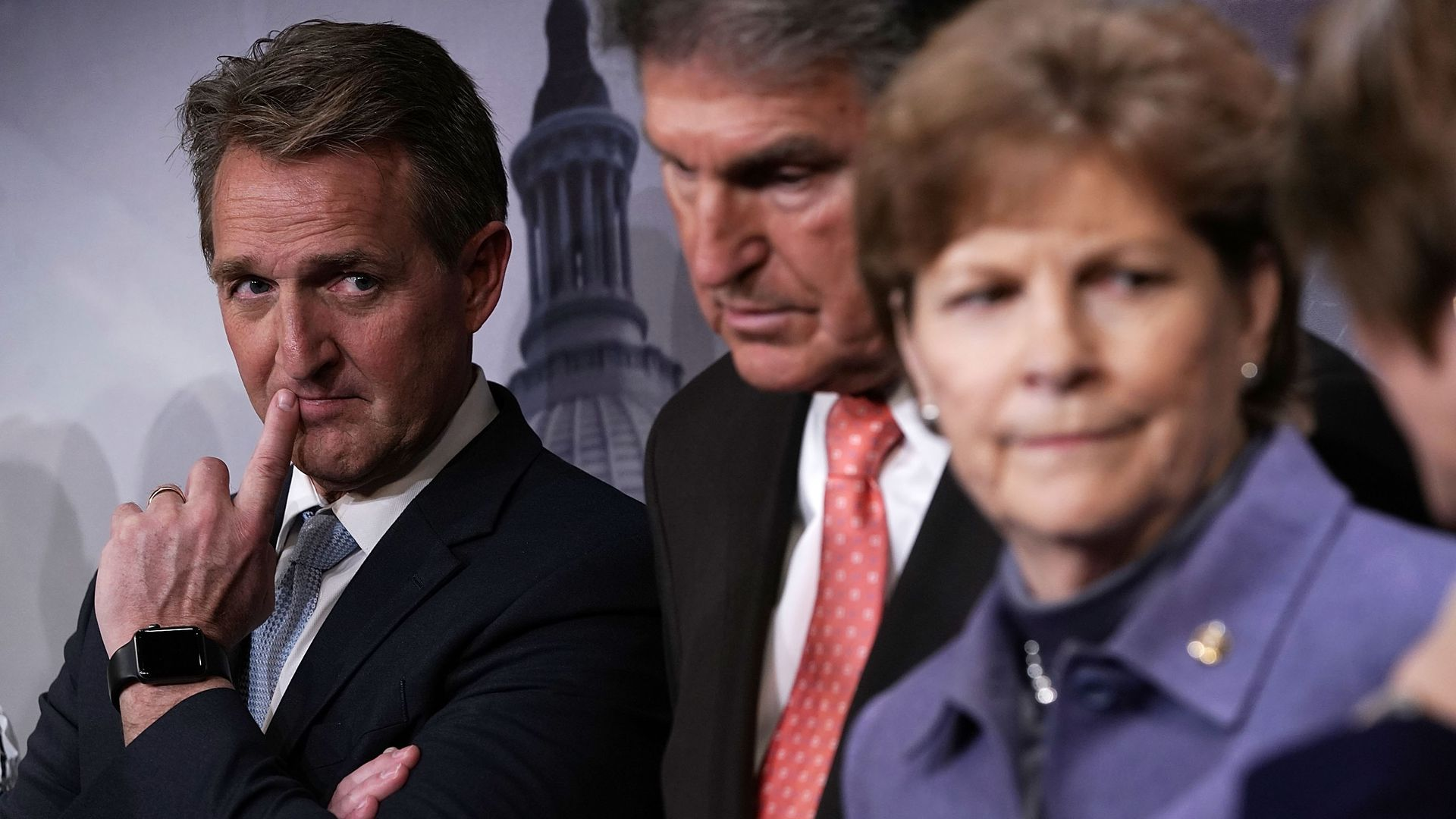 Sen. Jeff Flake with Sens. Joe Manchin and Jeanne Shaheen