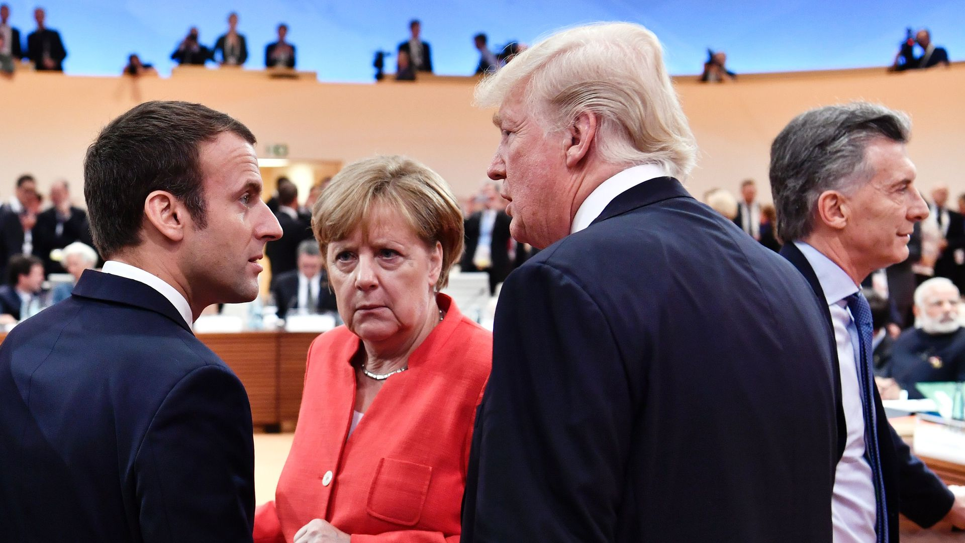 Emmanuel Macron, Angela Merkel, and Donald Trump.