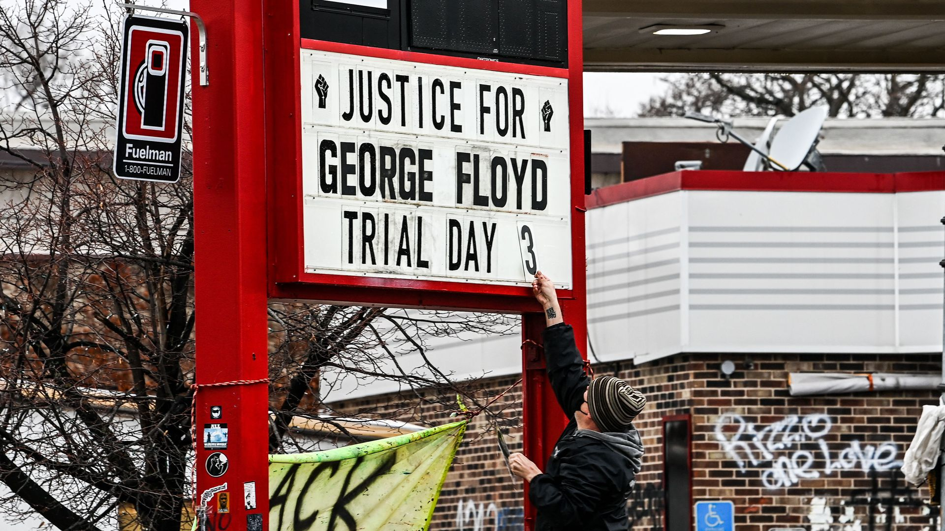 a sign saying justice for george floyd