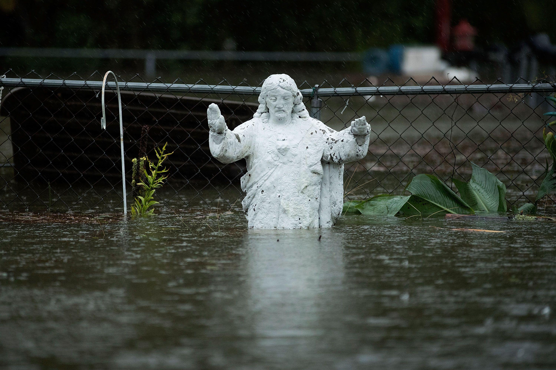 An angel statue halfway under water.
