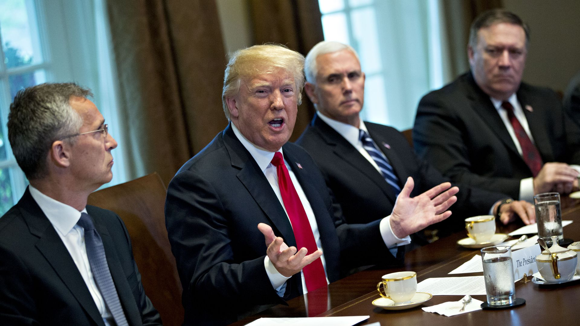 U.S. President Donald Trump speaks as Mike Pence, Mike Pompeo, and Jens Stoltenberg, secretary general of NATO, listen during a meeting in the Cabinet Room of the White House on May 17, 2018.