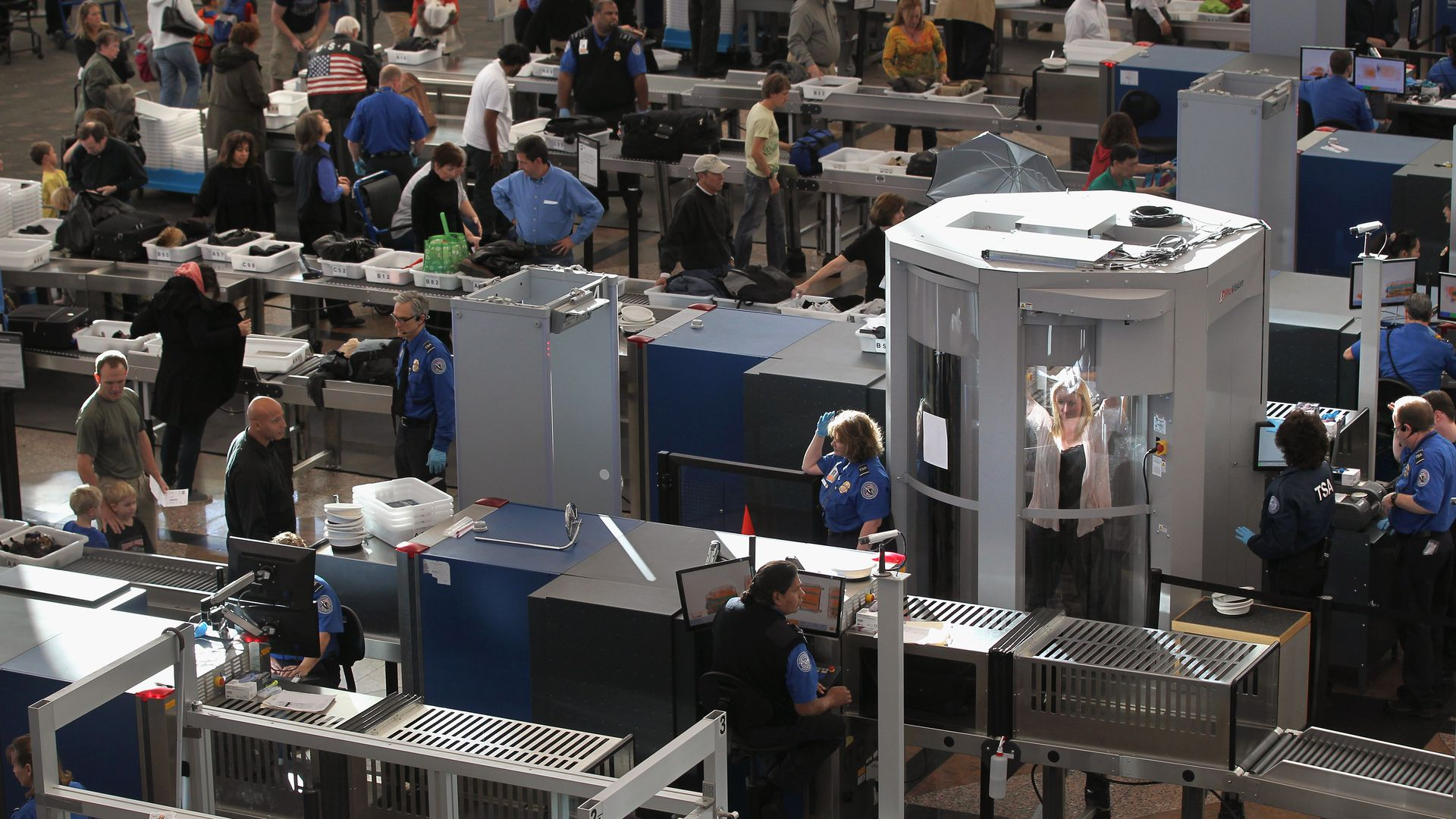 Travelers making their way through the Transportation Security Administration security checkpoint at the Denver International Airport. Photo: John Moore/Getty Images