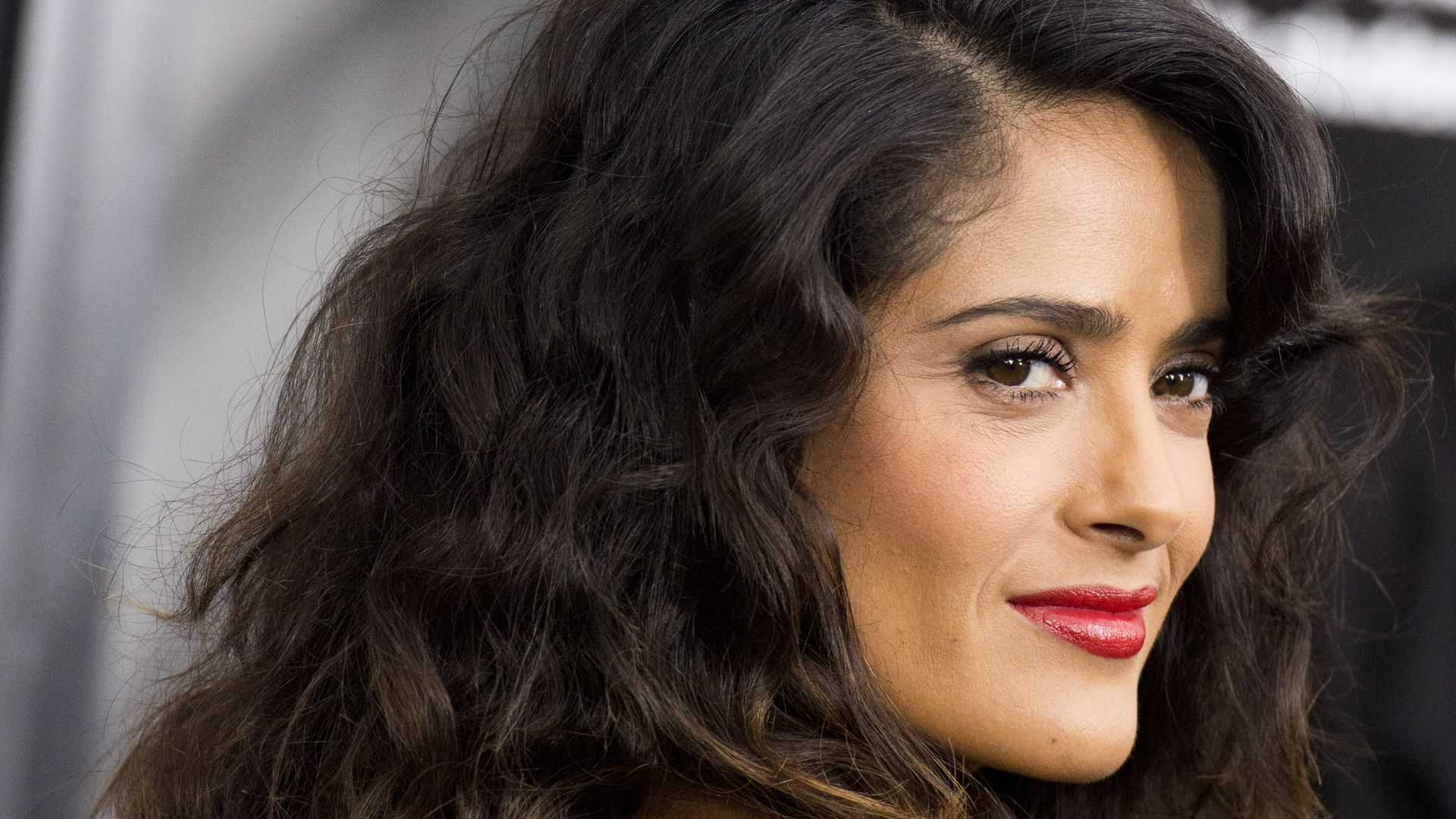 Mexican-American actress Salma Hayek looks over her shoulder.