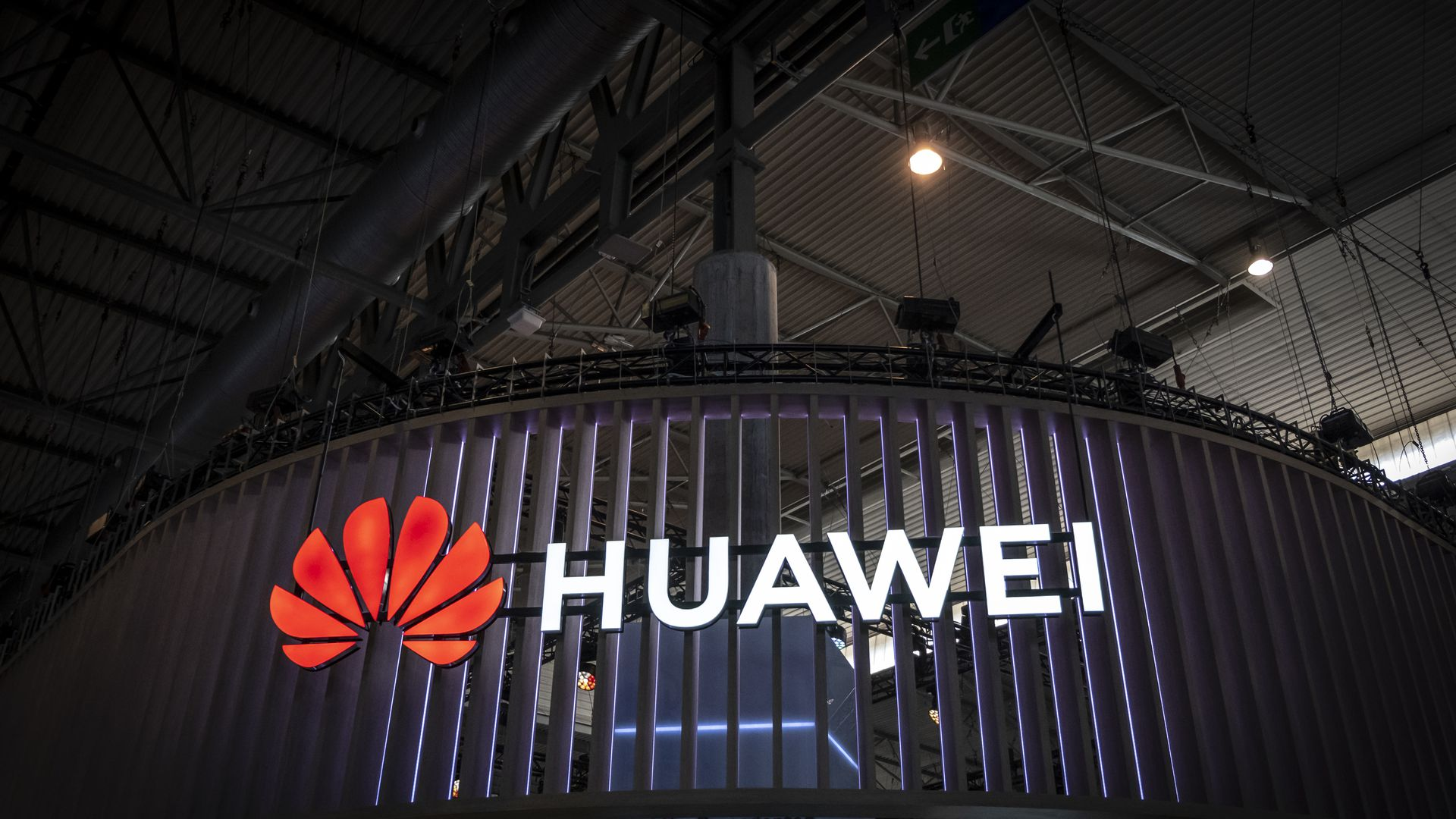 Huawei neon sign on a building