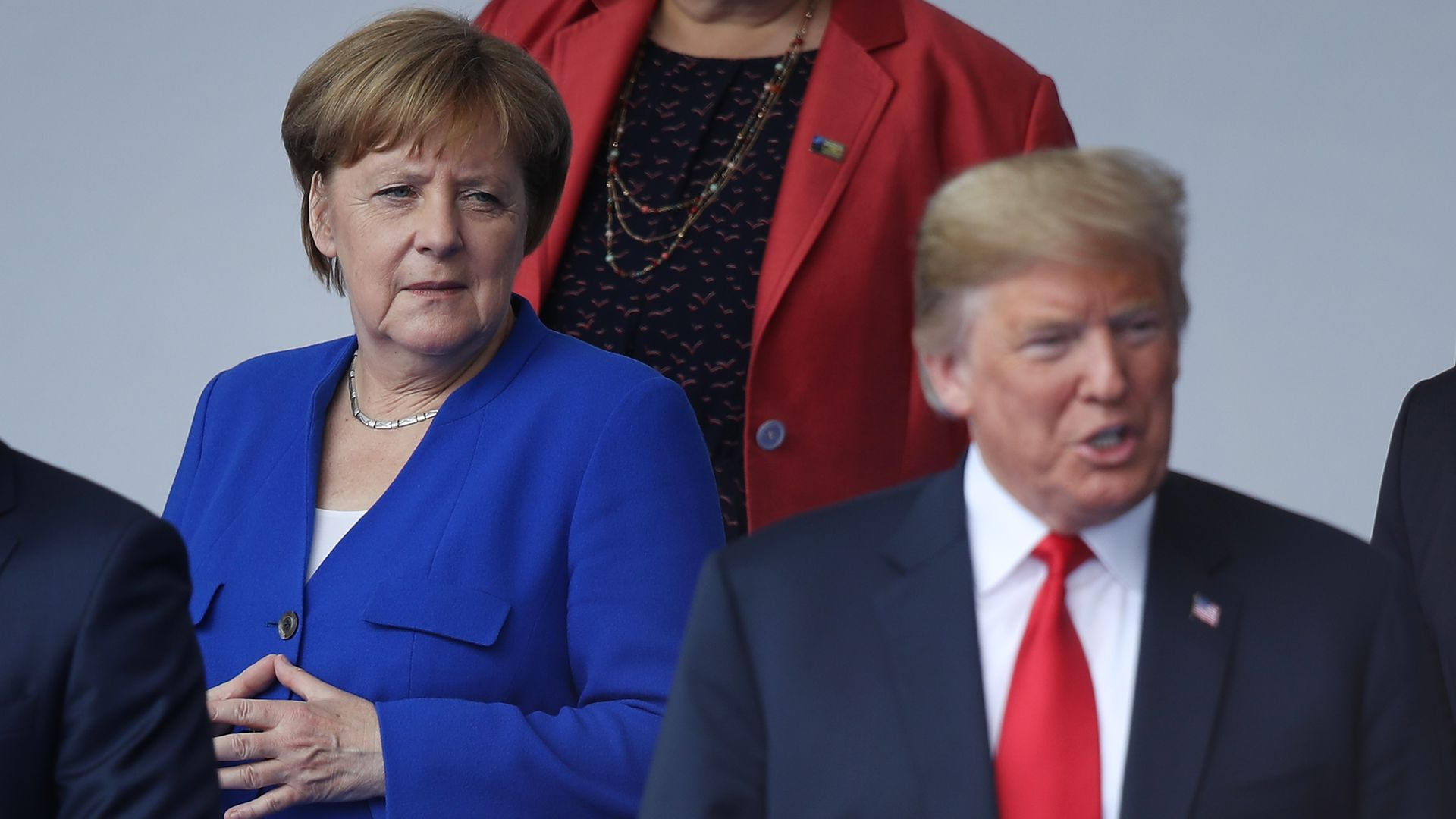 Angela Merkel looking at Donald Trump.