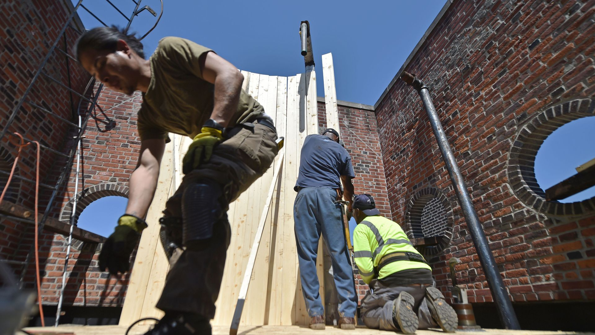 Construction workers in New York. Photo: Hector Retamal/AFP/Getty Images