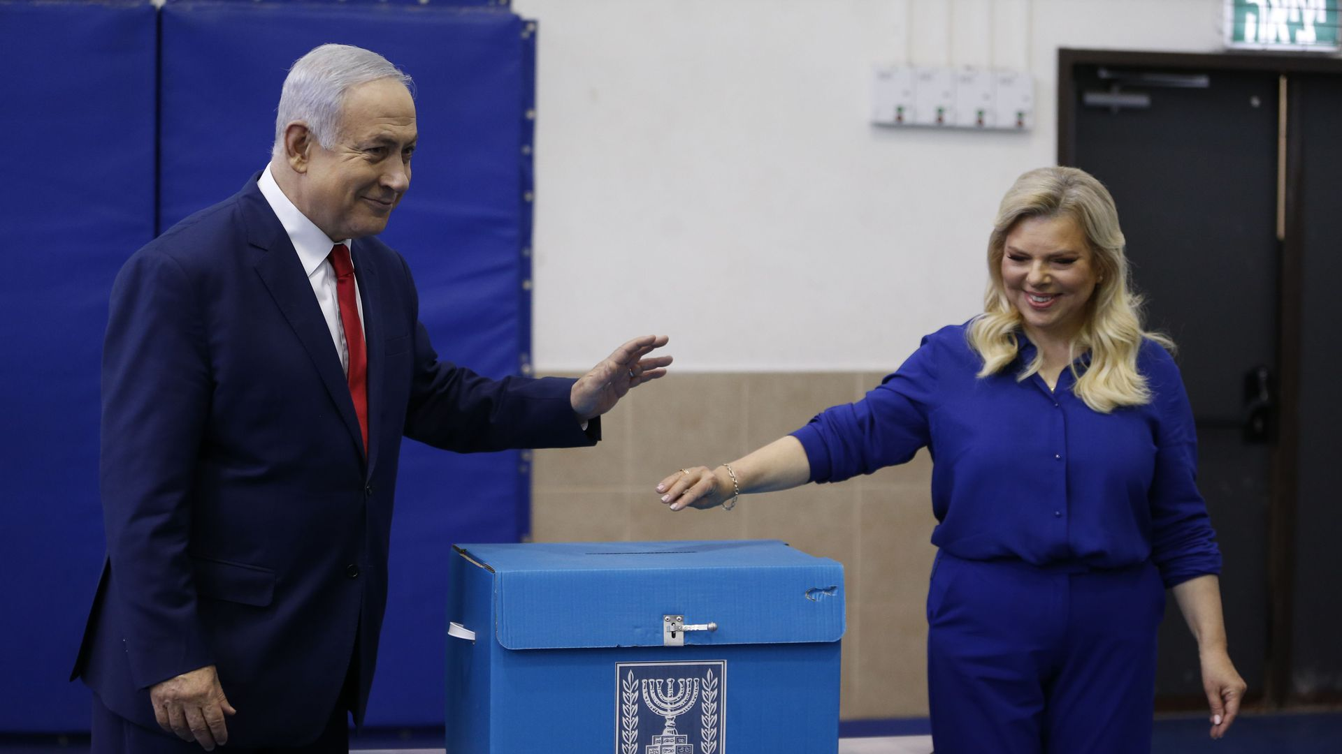 Netanyahu voting with his wife