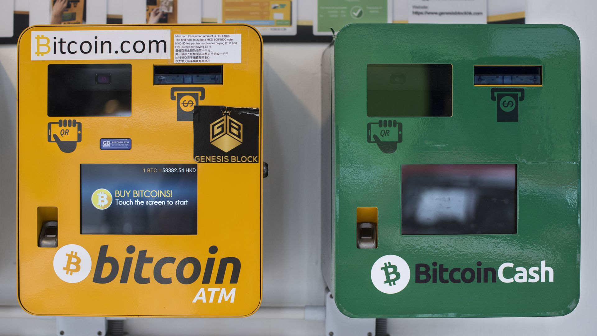Two Bitcoin ATM machines, one yellow, one green, in Hong Kong