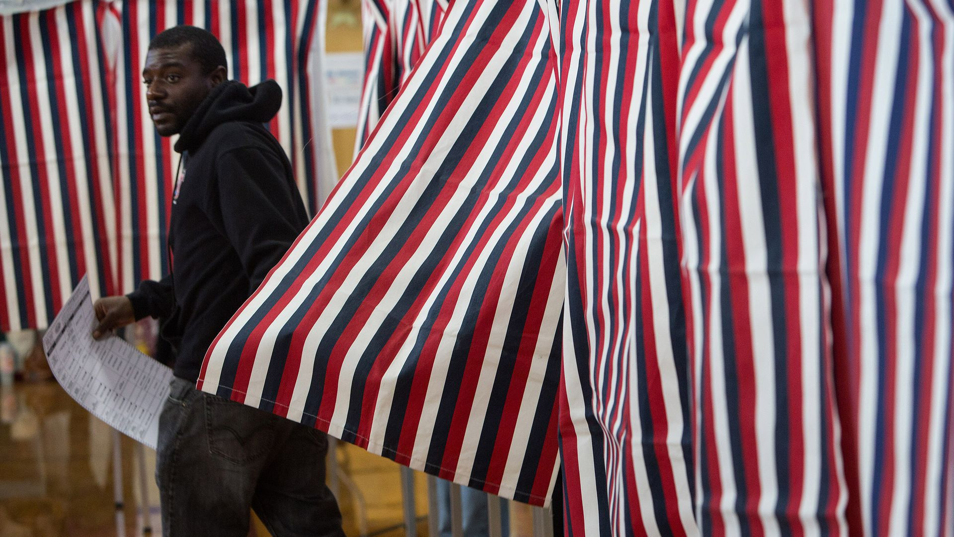 A New Hampshire voter casts his ballot at Amherst Street Elementary School.