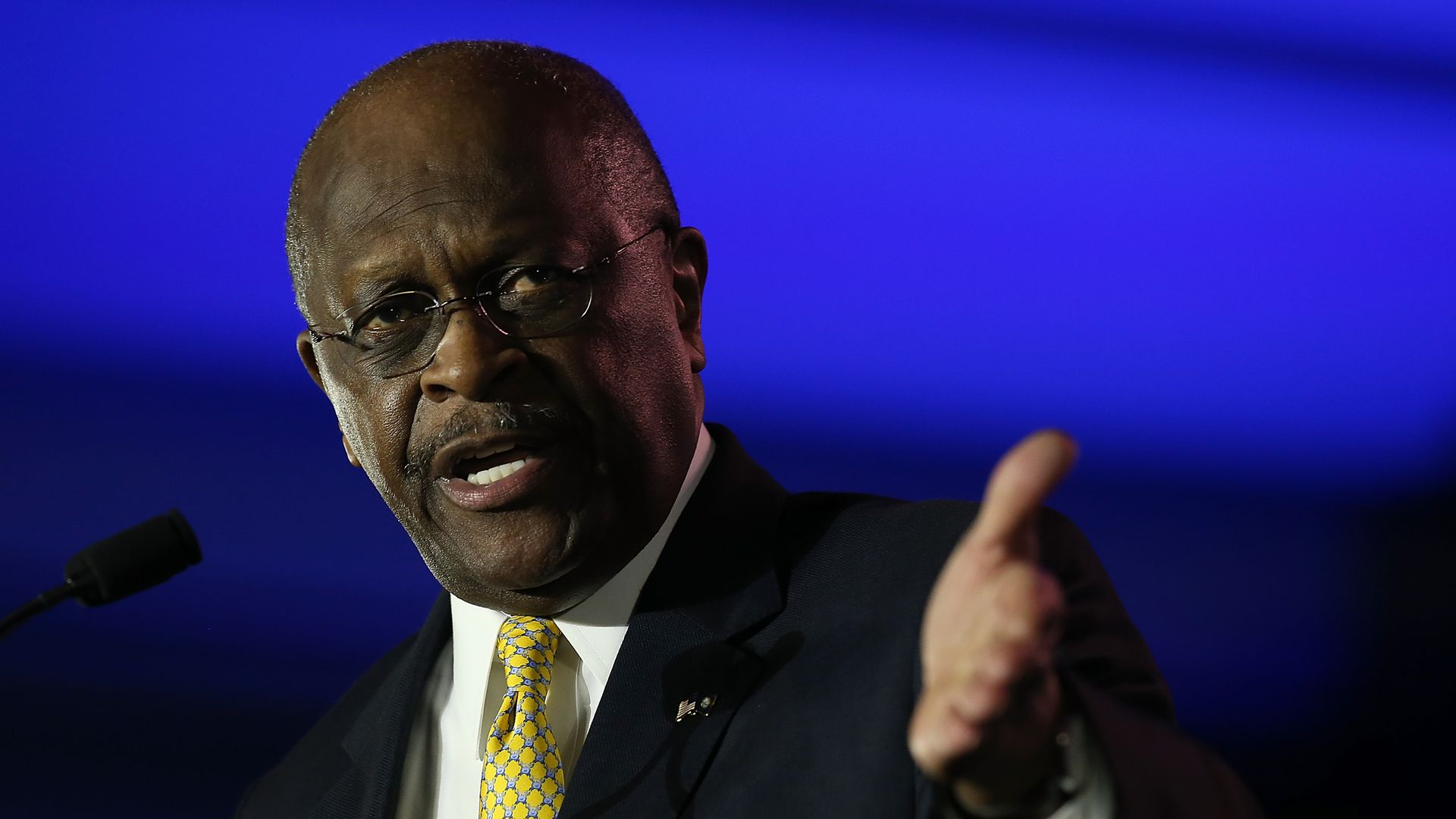 Herman Cain giving a speech
