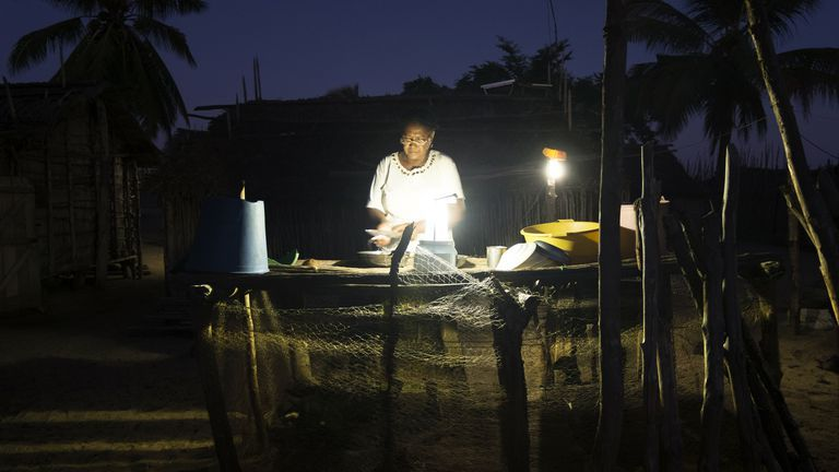 Photo of woman working at night with a light in Madagascar