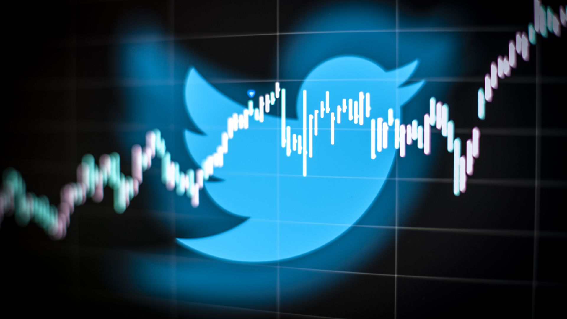 Photo illustration of Twitter logo with trend line going across it.