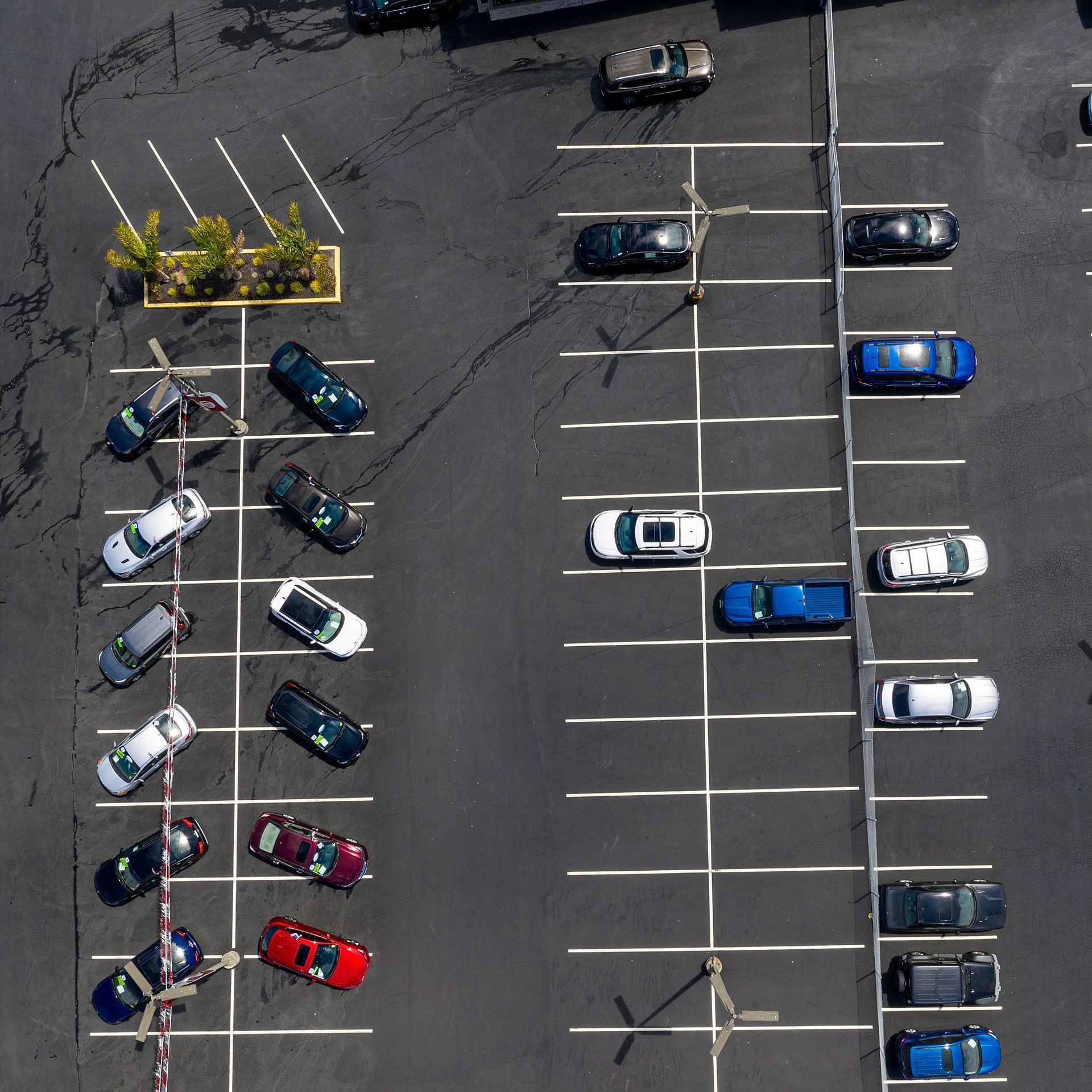 An aerial view of a mostly empty car lot