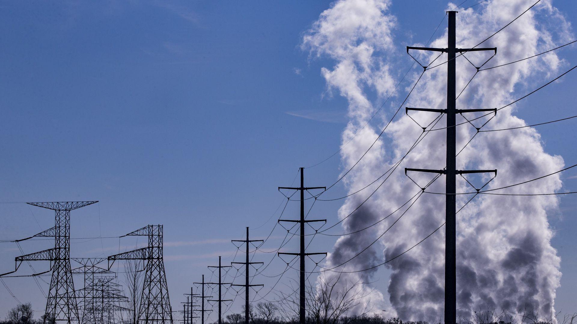 Smoke billows near power lines