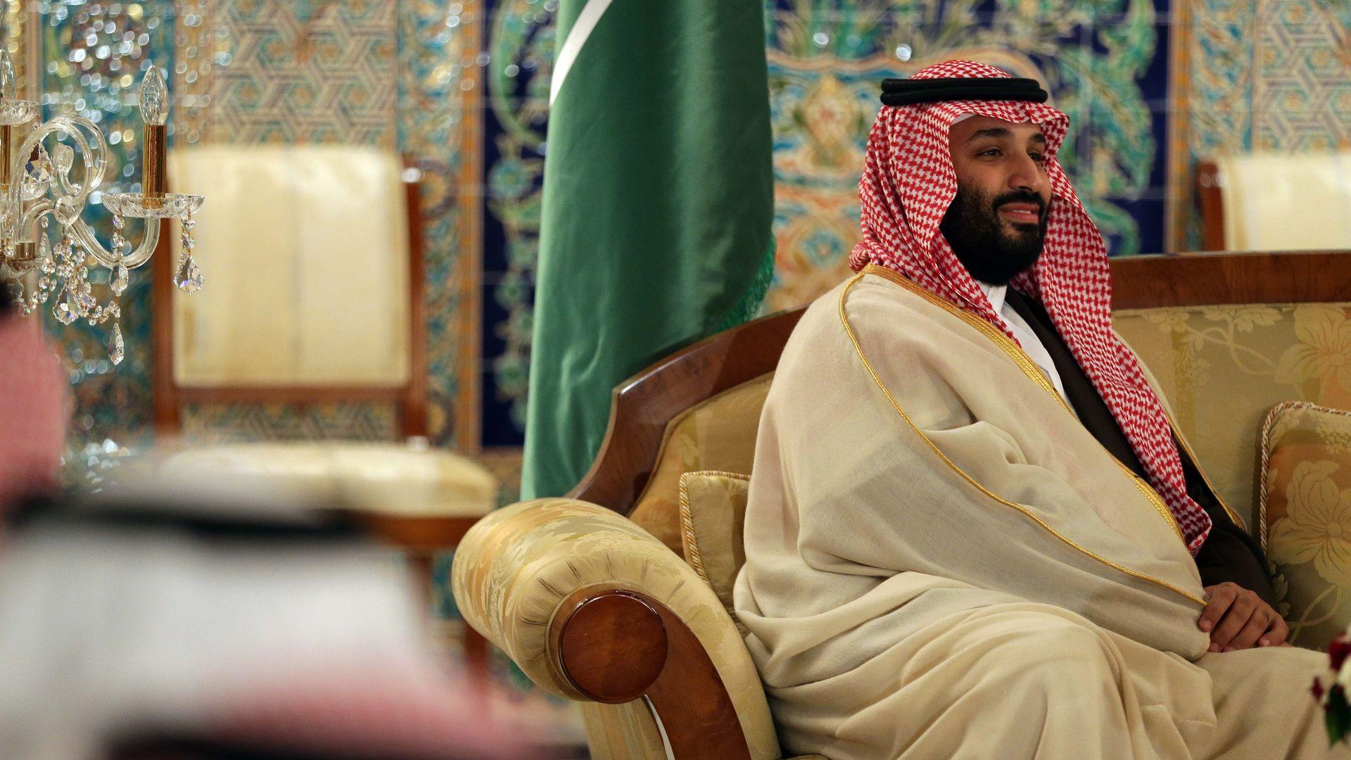 Mohammed bin Salman looks happy.