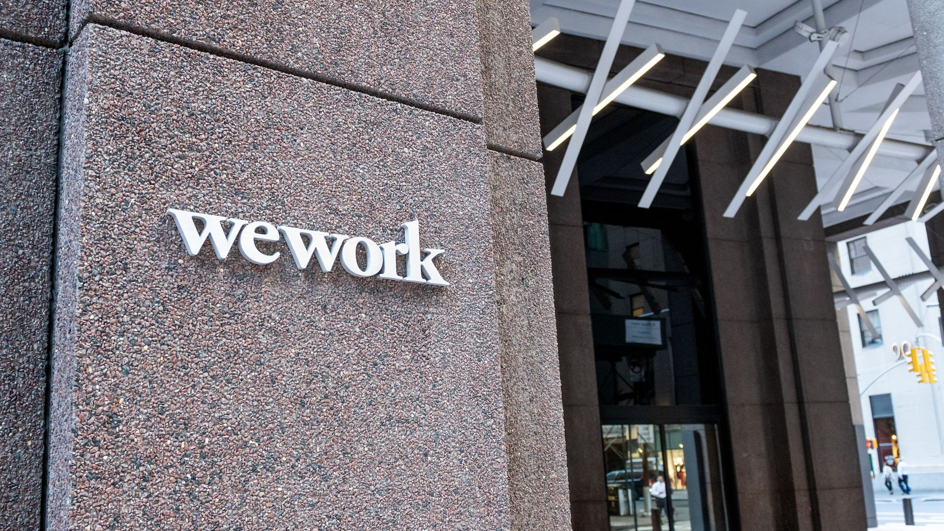 Photo of a WeWork sign on one of its New York buildings.