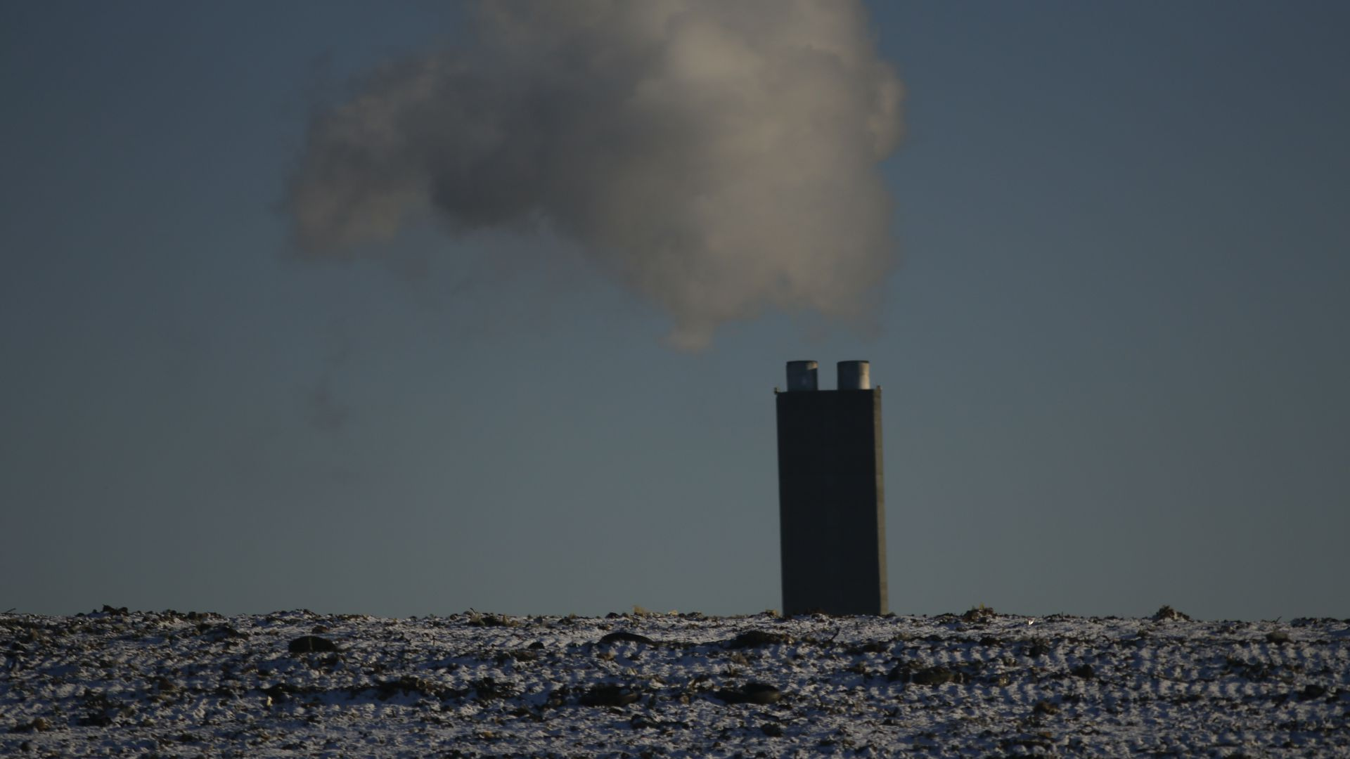 A factory emits smoke