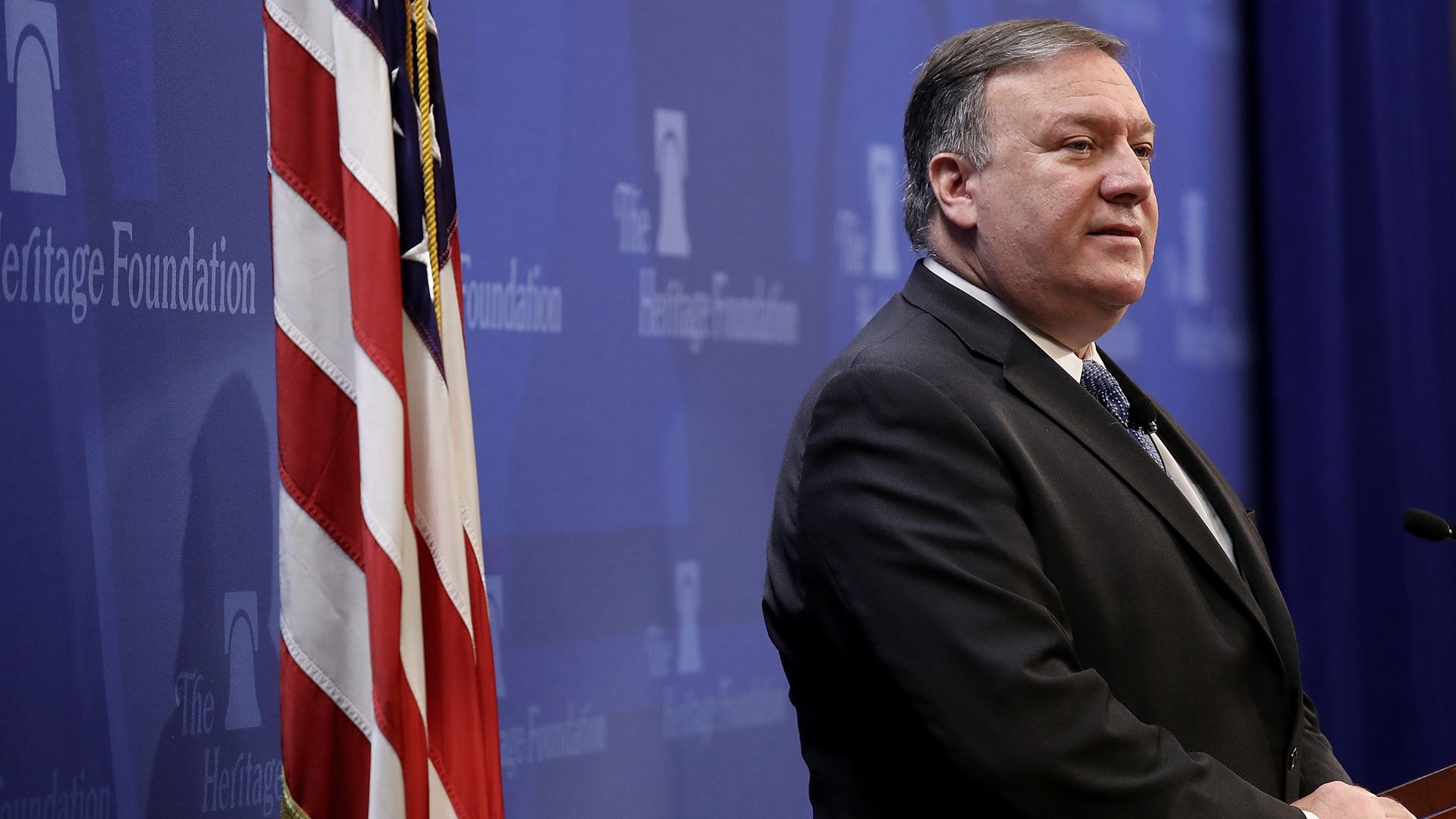 Mike Pompeo at lectern with American flag