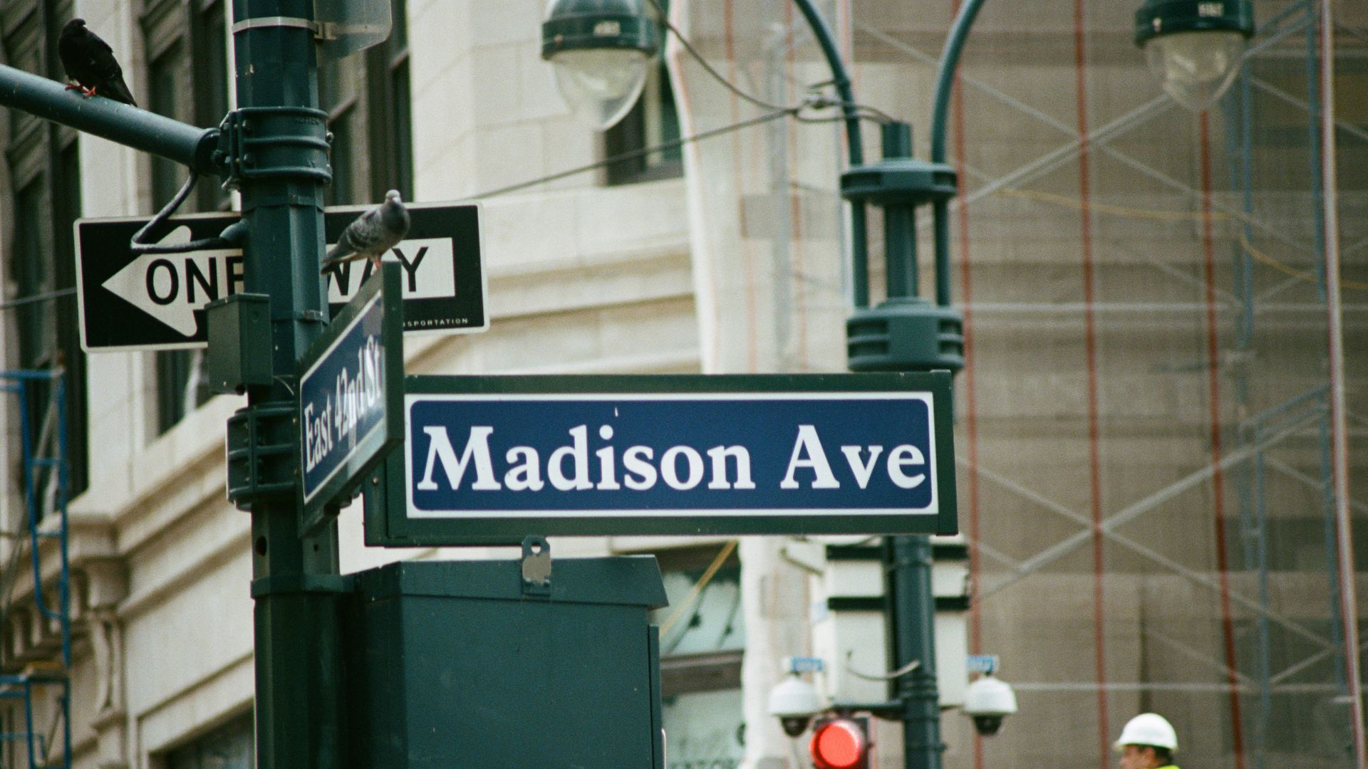 In this image, the street sign for Madison Avenue in New York is visible.