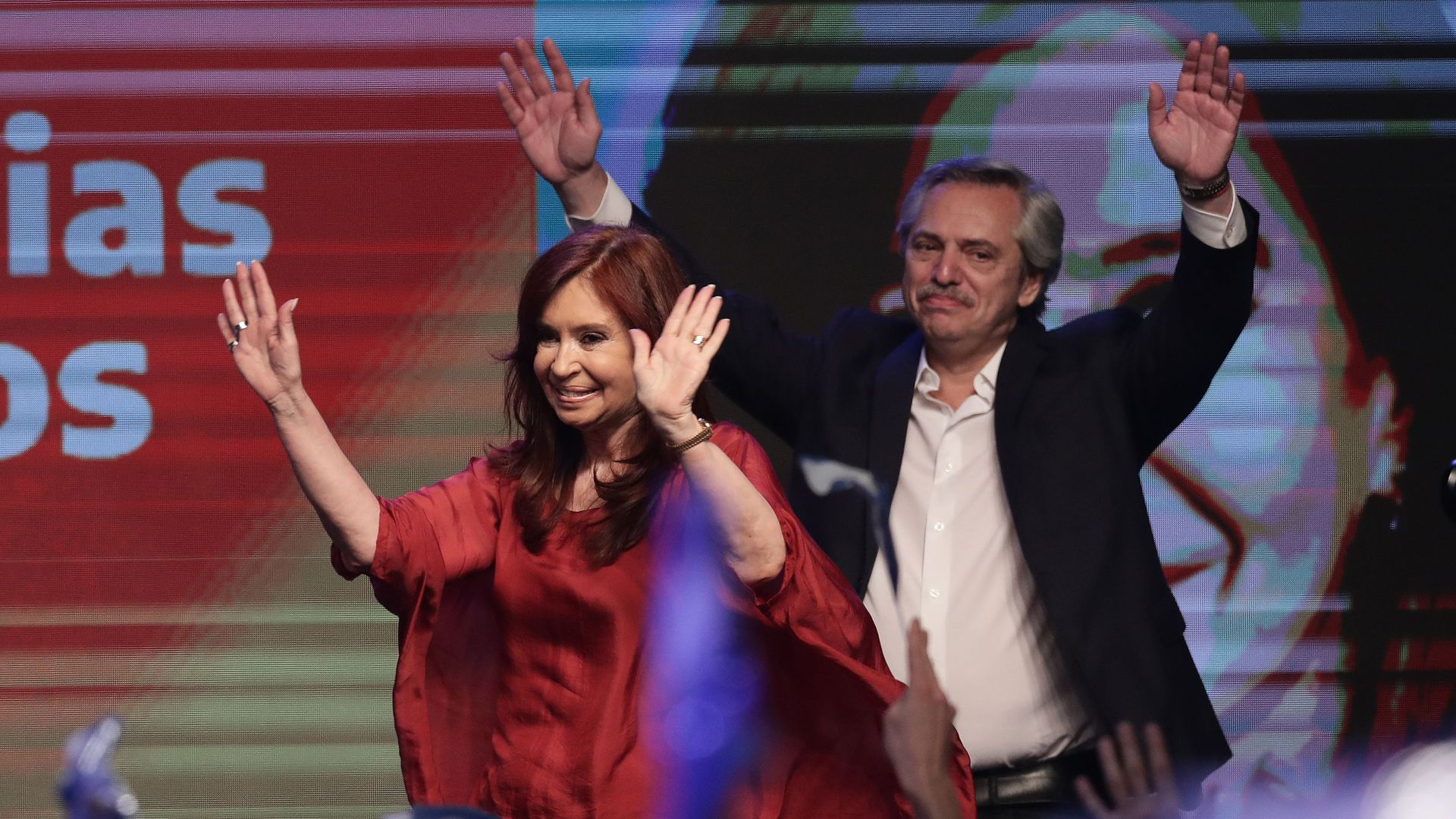 Argentina's president elect Alberto Fernandez and vice-president Cristina Fernandez wave at supporters at the headquarters of the party in Buenos Aires on October 27