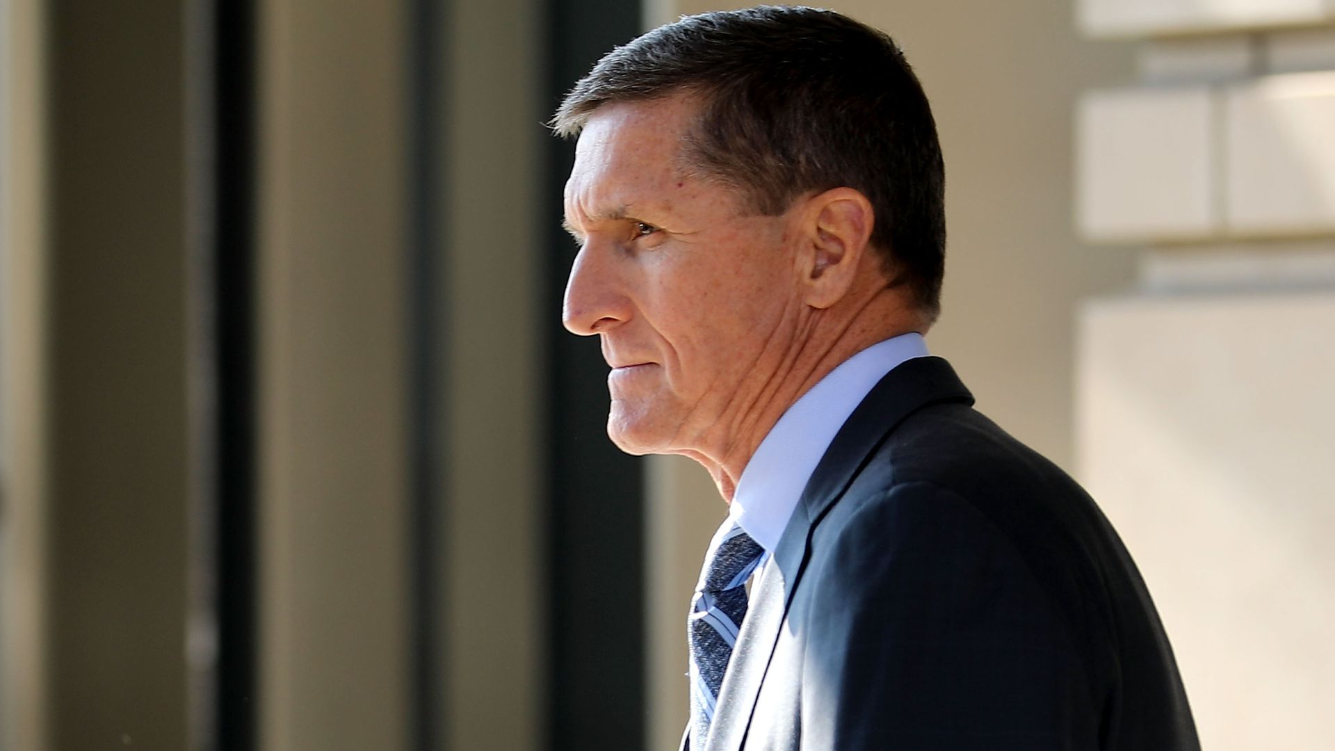 Michael Flynn outside in a suit.