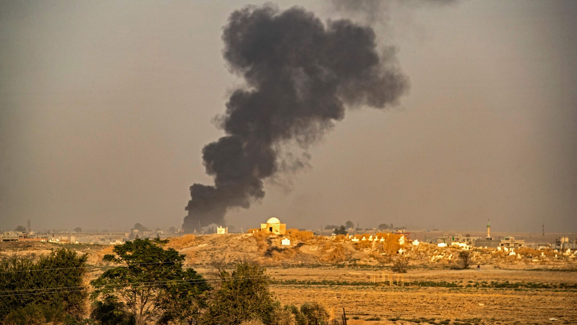 Smoke following Turkish bombardment on Syrian town of Ras al-Ain.