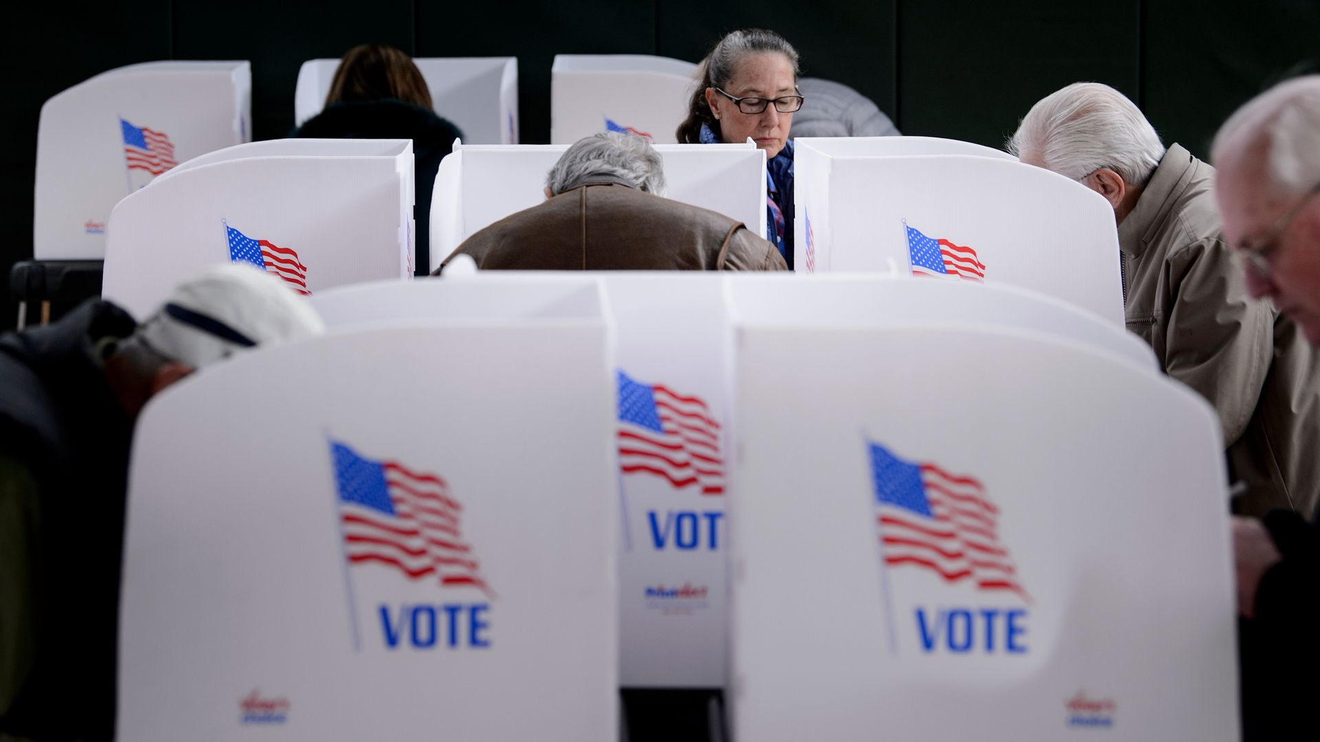People cast their ballots at a community center during early voting October 25, 2018 in Potomac, Maryland