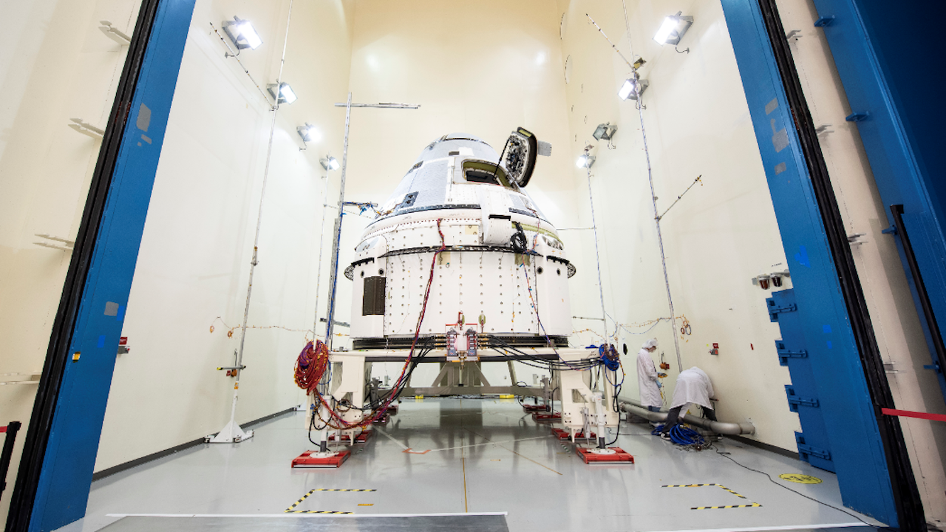 The CST-100 Starliner in a clean room at NASA.