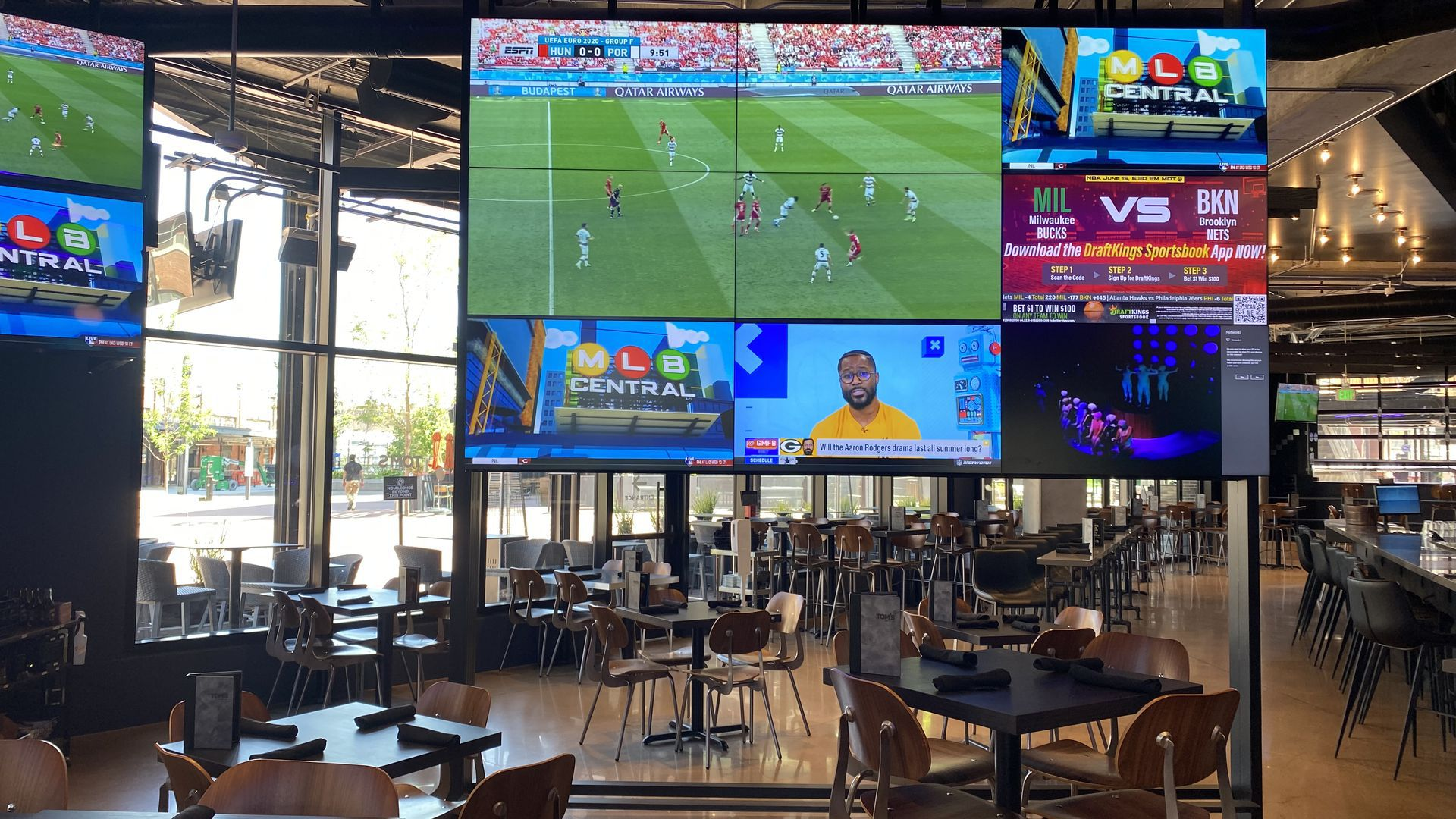 The interior of a sports bar, Tom's Watch Bar, in Denver.