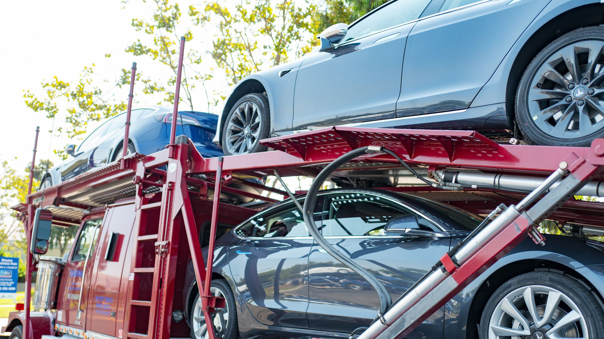 Photo of Teslas on a car carrier ready to be delivered