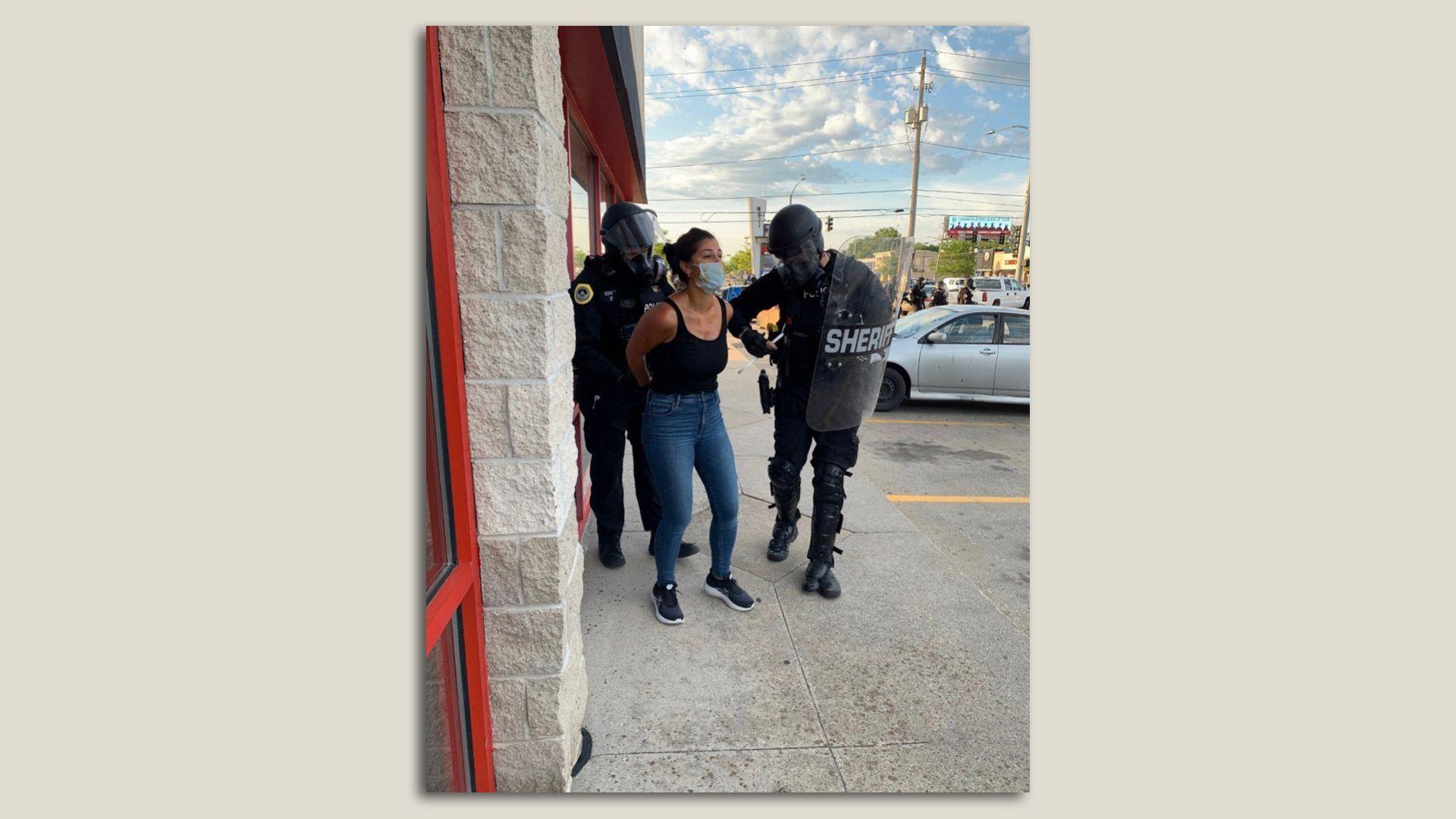 Des Moines police arrest reporter Andrea Sahouri outside Merle Hay Mall. Photo courtesy of Andrea Sahouri