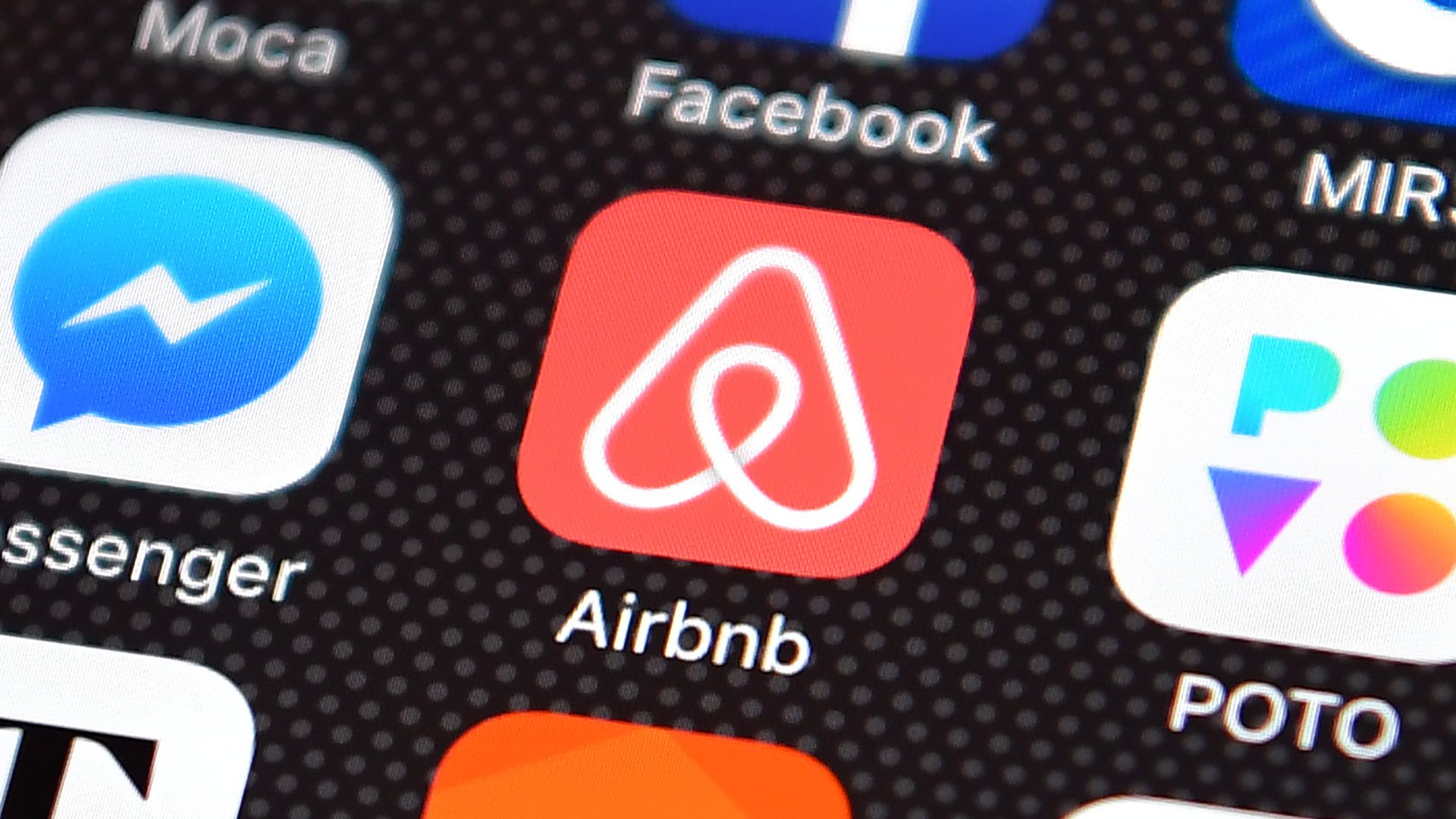 Airbnb app logo on smartphone.