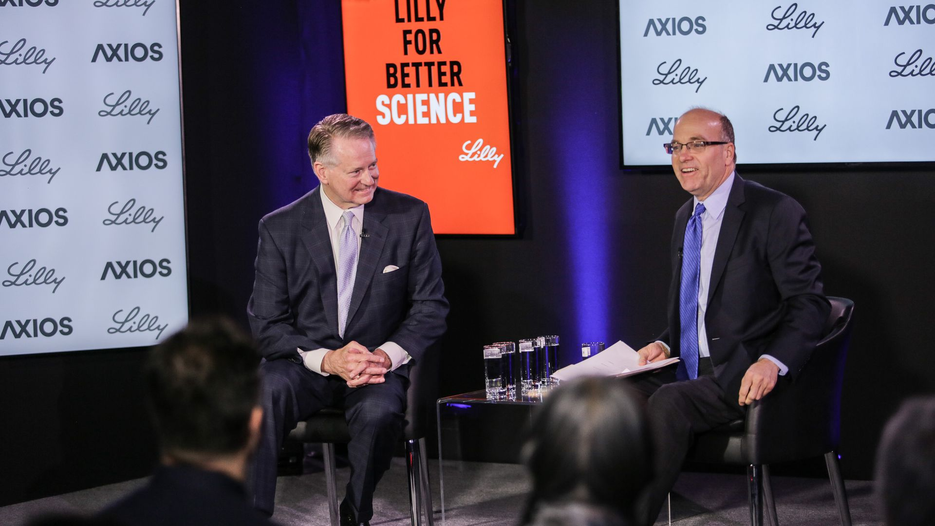 Mayor Steve Williams and Mike Allen sit on the Axios stage for an event.