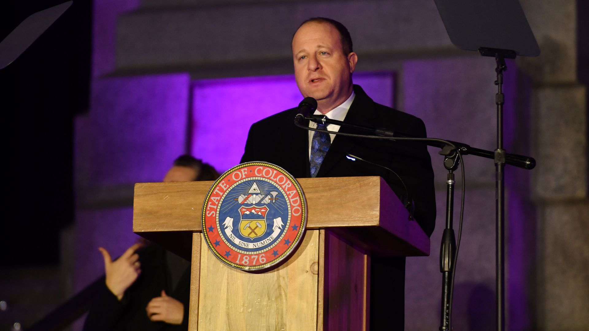 Gov. Jared Polis is in west step of State Capital building for Colorado for Statewide Evening of Remembrance in Denver, Colorado on Friday, March 5, 2021.