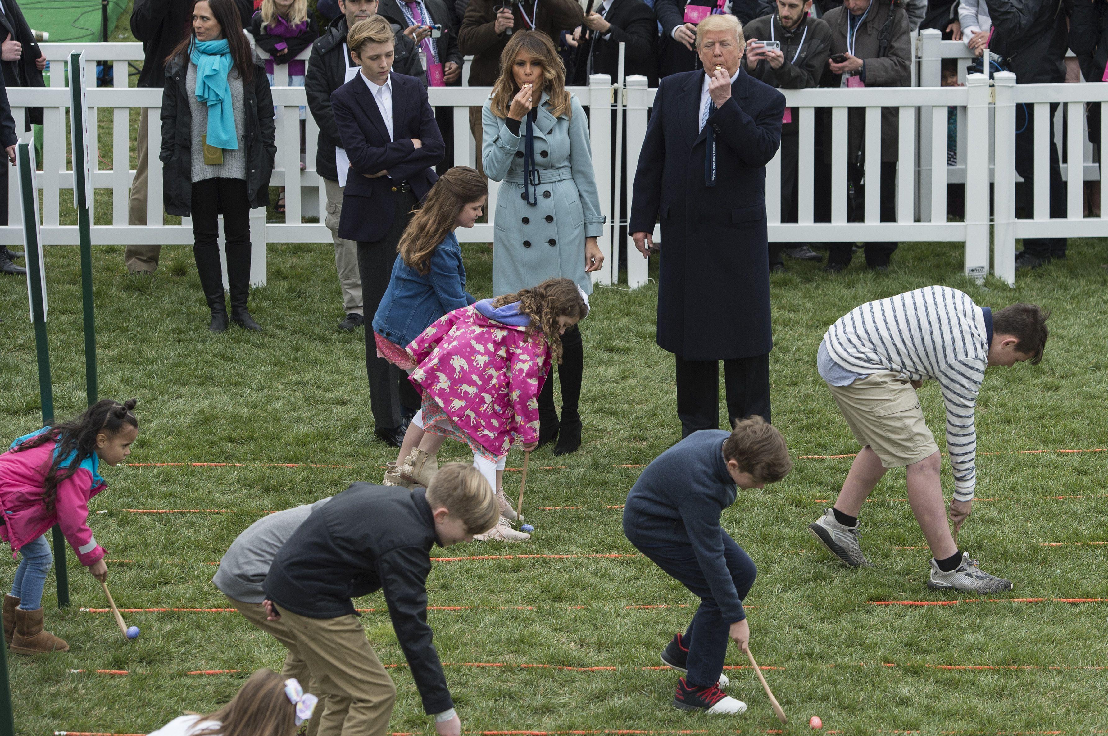 Children scooping eggs