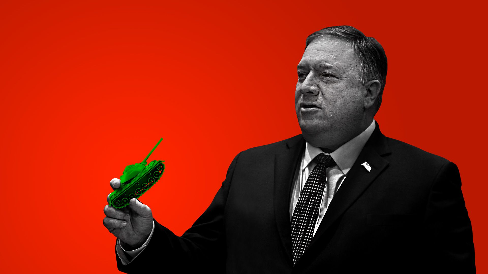 Mike Pompeo holding a miniature tank