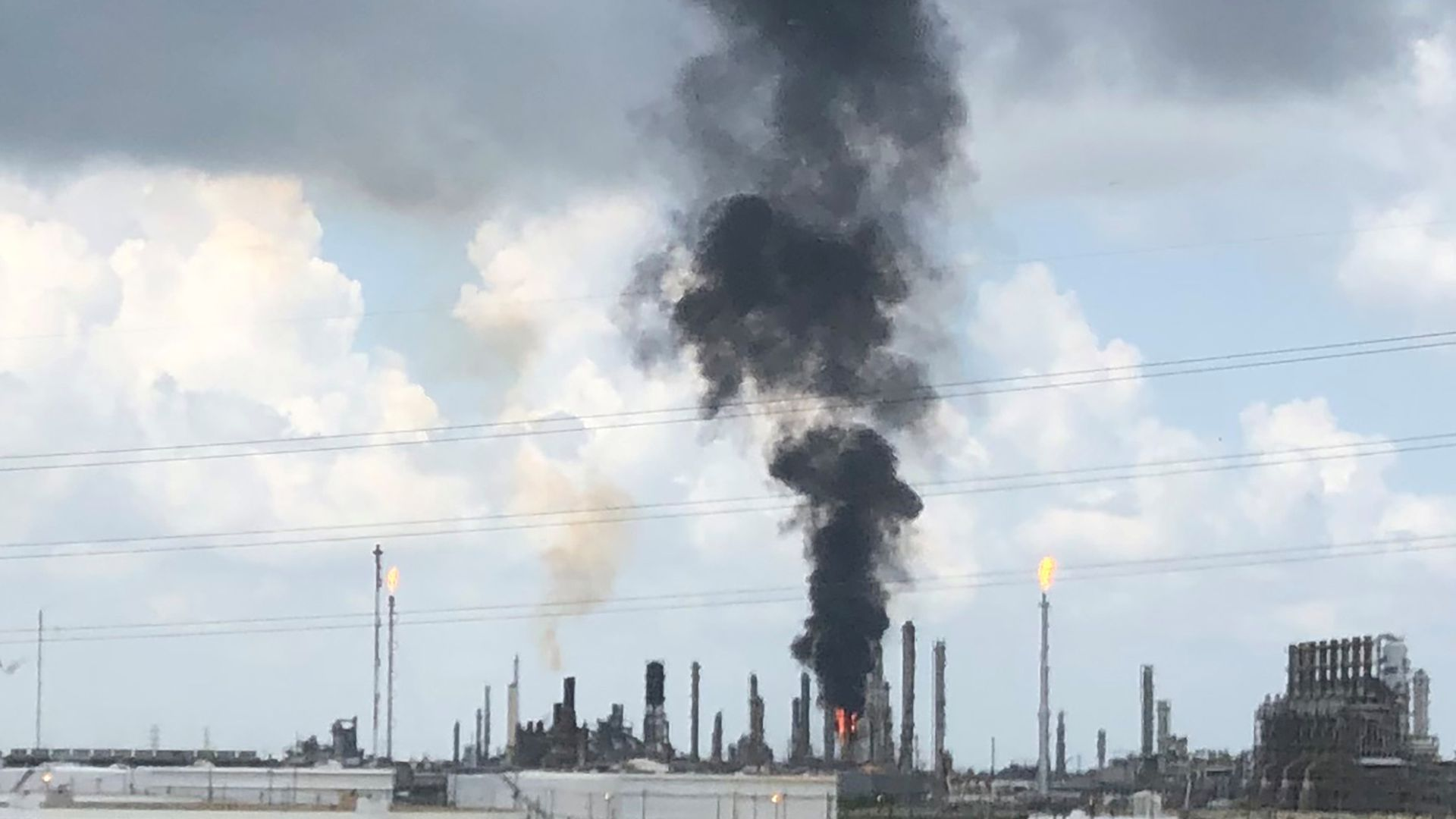 Smoke rises from a fire at Exxon Mobil's refining and chemical plant complex in Baytown, near Houston, Texas.
