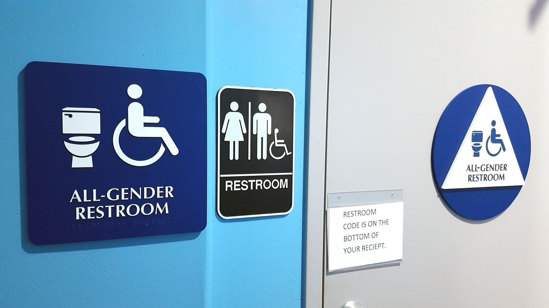 "Sign on a public restroom that says ""All gender bathroom"""