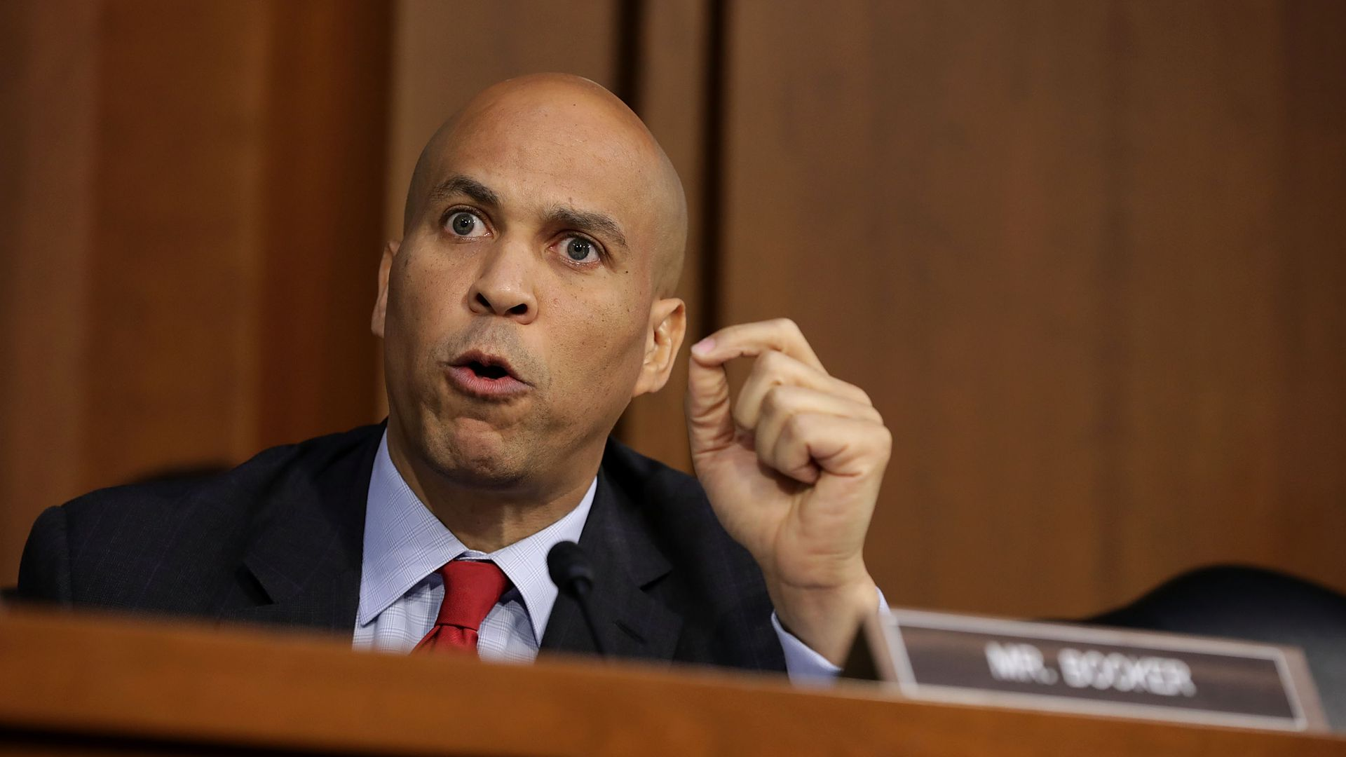 Sen. Cory Booker speaking angrily in a hearing