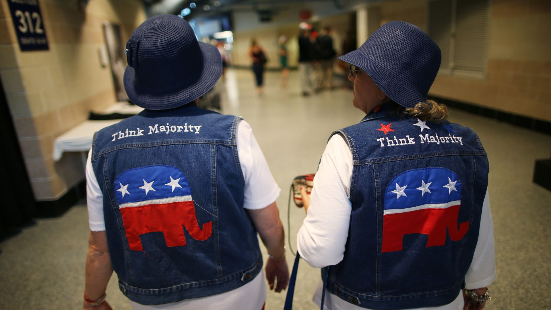 Two women don jean jackets with the GOP logo