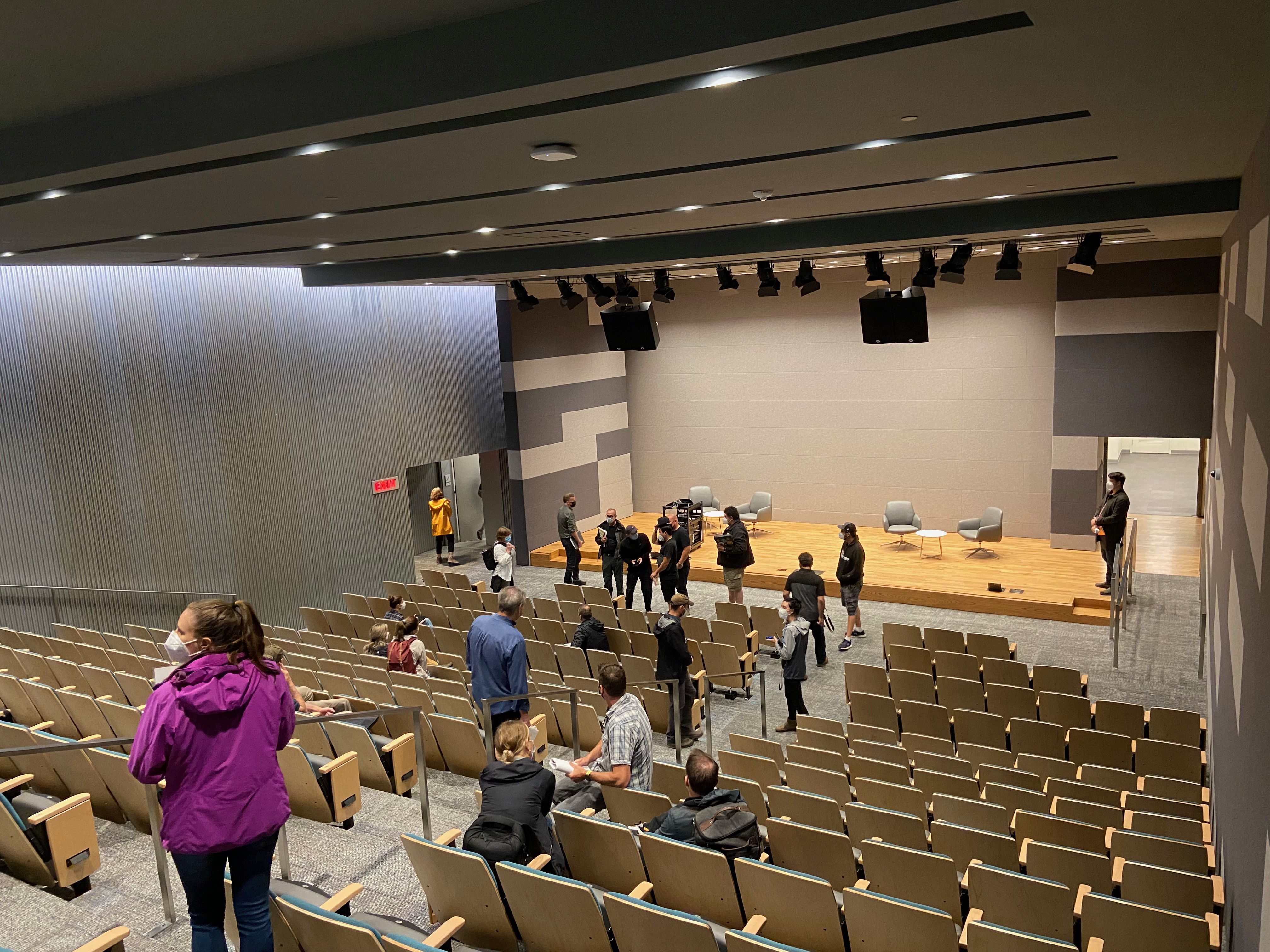 A photograph of people in the basement auditorium which has been revamped and brightened
