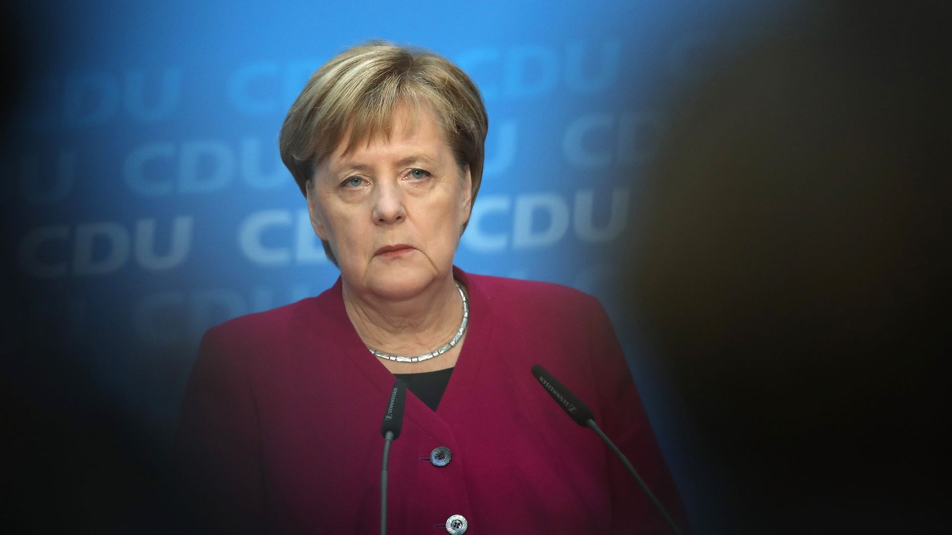 Angela Merkel at a podium