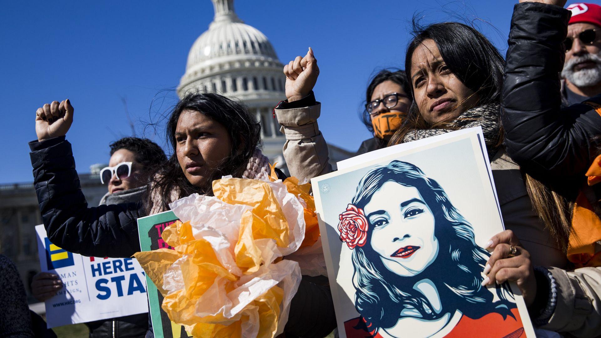 DACA protestors raise right fists