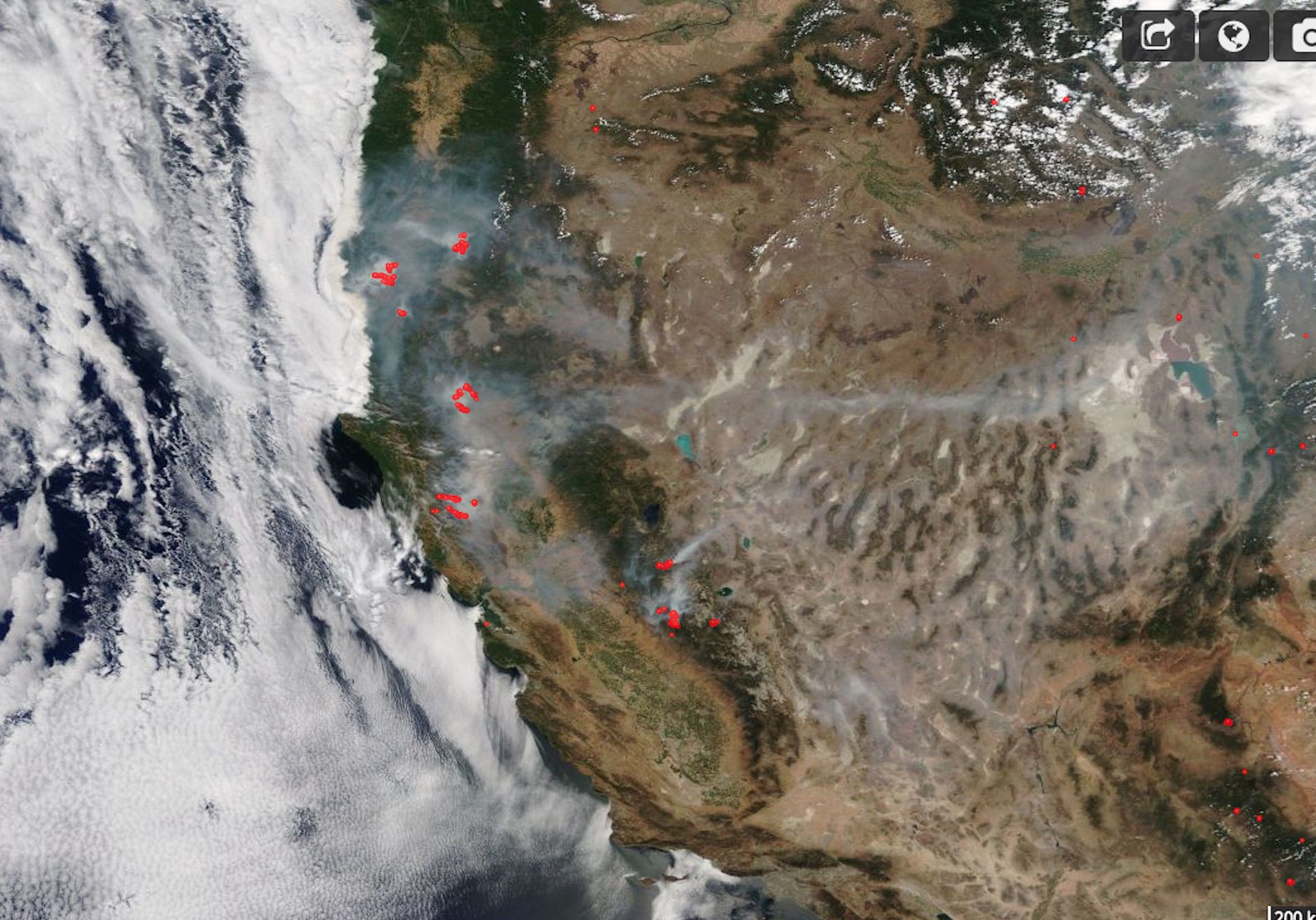 Satellite image shows wildfire heat signatures in red and smoke plumes from large wildfires burning on Aug. 6, 2018.