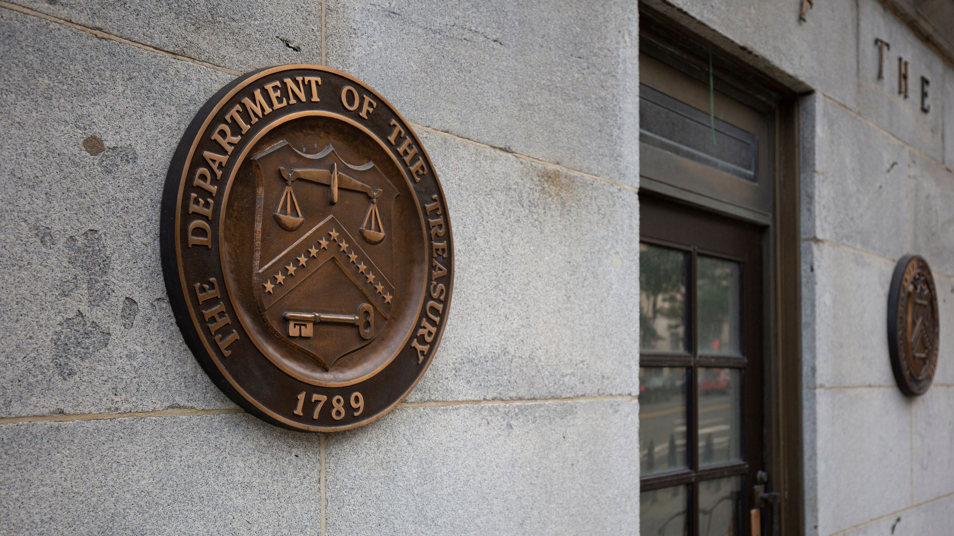 Treasury Department logo outside of the building