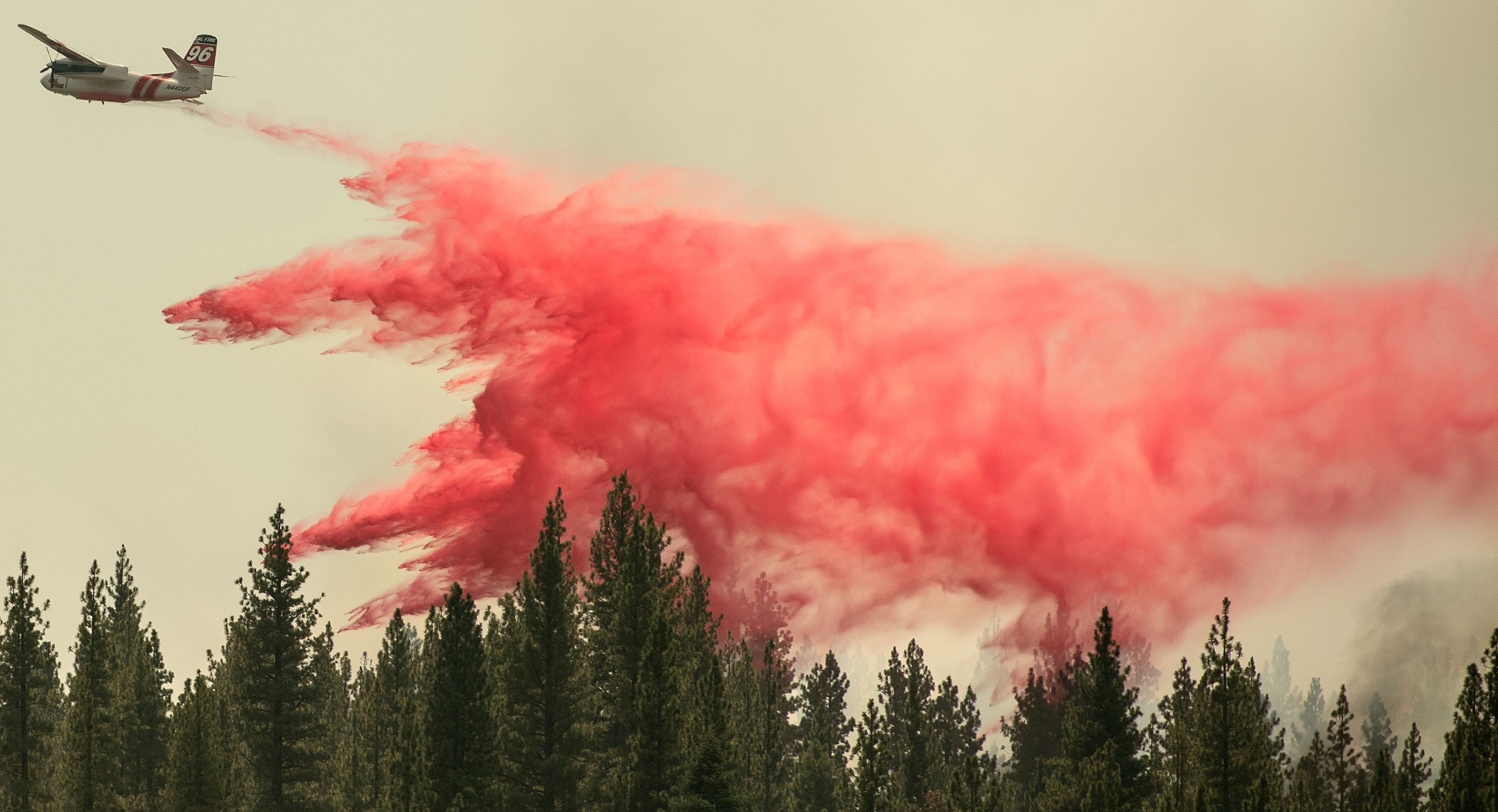 A Cal Fire aircraft drops fire retardant over the Hog Fire, near Susanville, California, on July 21.