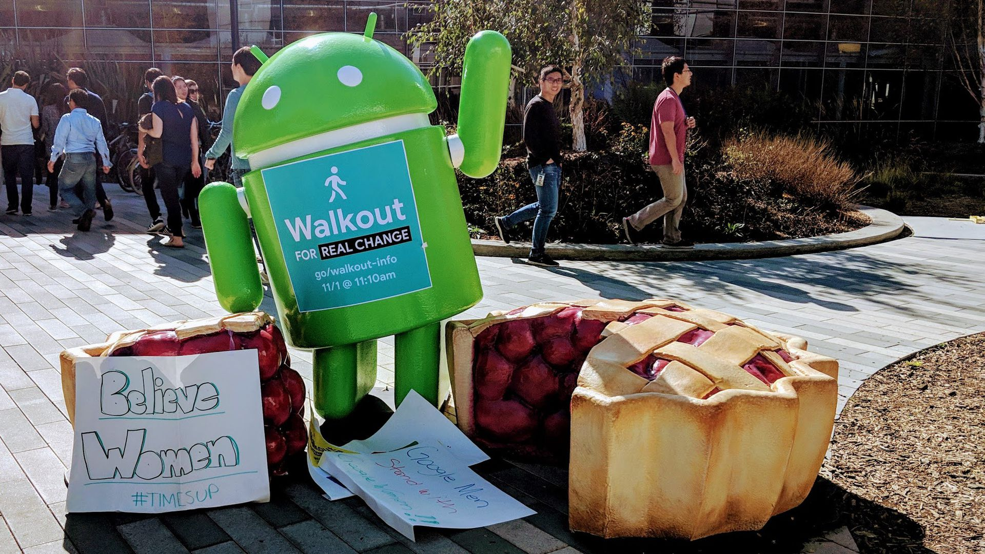 An Android Pie statue on Google's campus with signs from the worker protest.