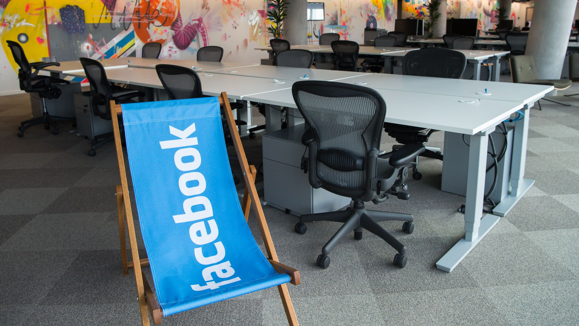 Deserted desks and a reclining chair featuring the logo of 'Facebook' stand in the new office of 'Facebook Deutschland' at the Potsdamer Platz in Berlin, Germany,