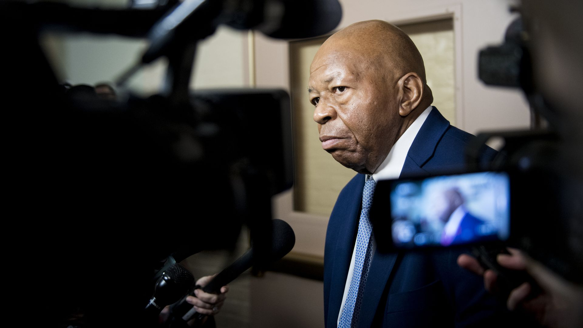 Rep. Elijah Cummings, D-Md., leaves the House Democrats' caucus meeting in the Capitol